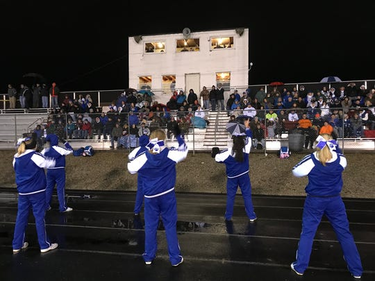 Cheerleaders and fans of Southeastern support their team during a high school football playoff game this fall at Northmor. The importance of high school athletics isn't quite what it was a generation ago.