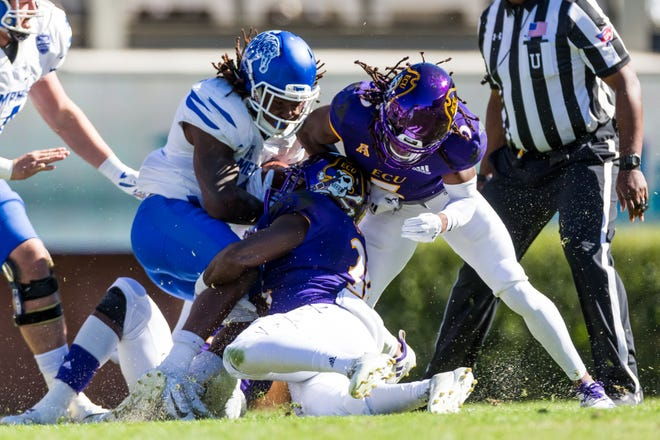 Memphis running back Darrell Henderson is tackled after a run against ECU on November 3, 2018