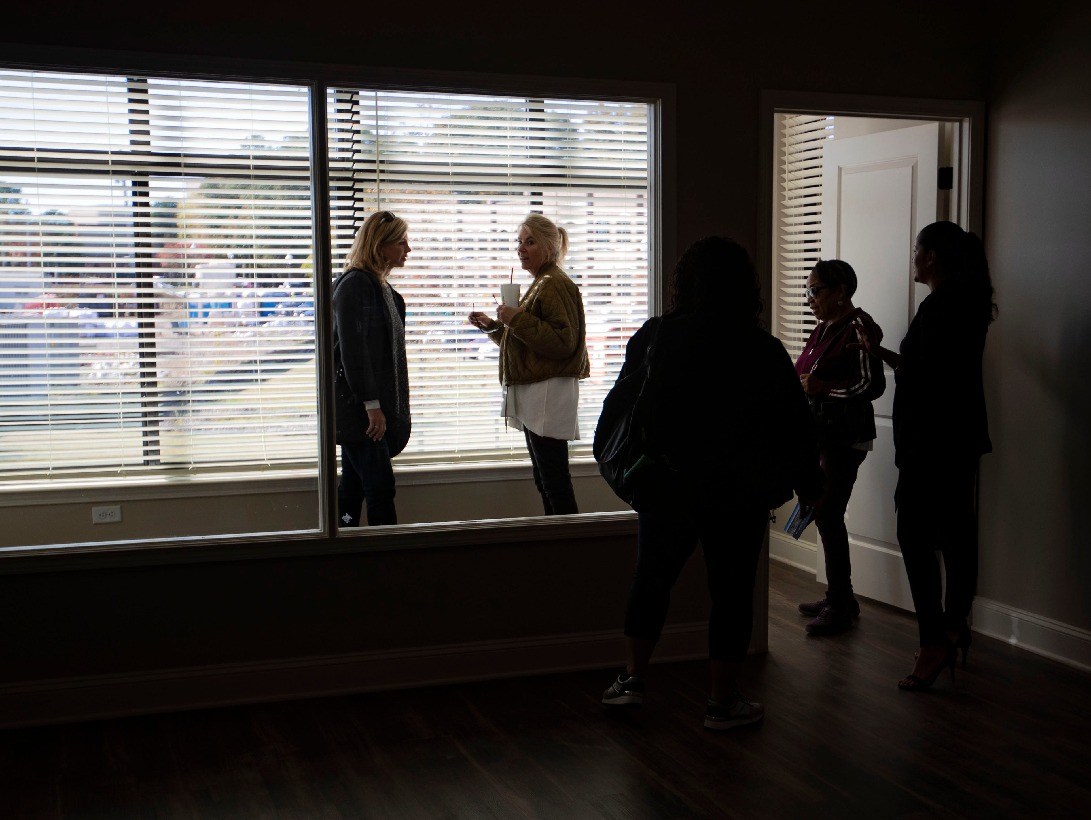 Elizabeth Renteria shows visitors around a two bedroom apartment during Thornwood Development open house in Germantown TN., Saturday  November 3, 2018.