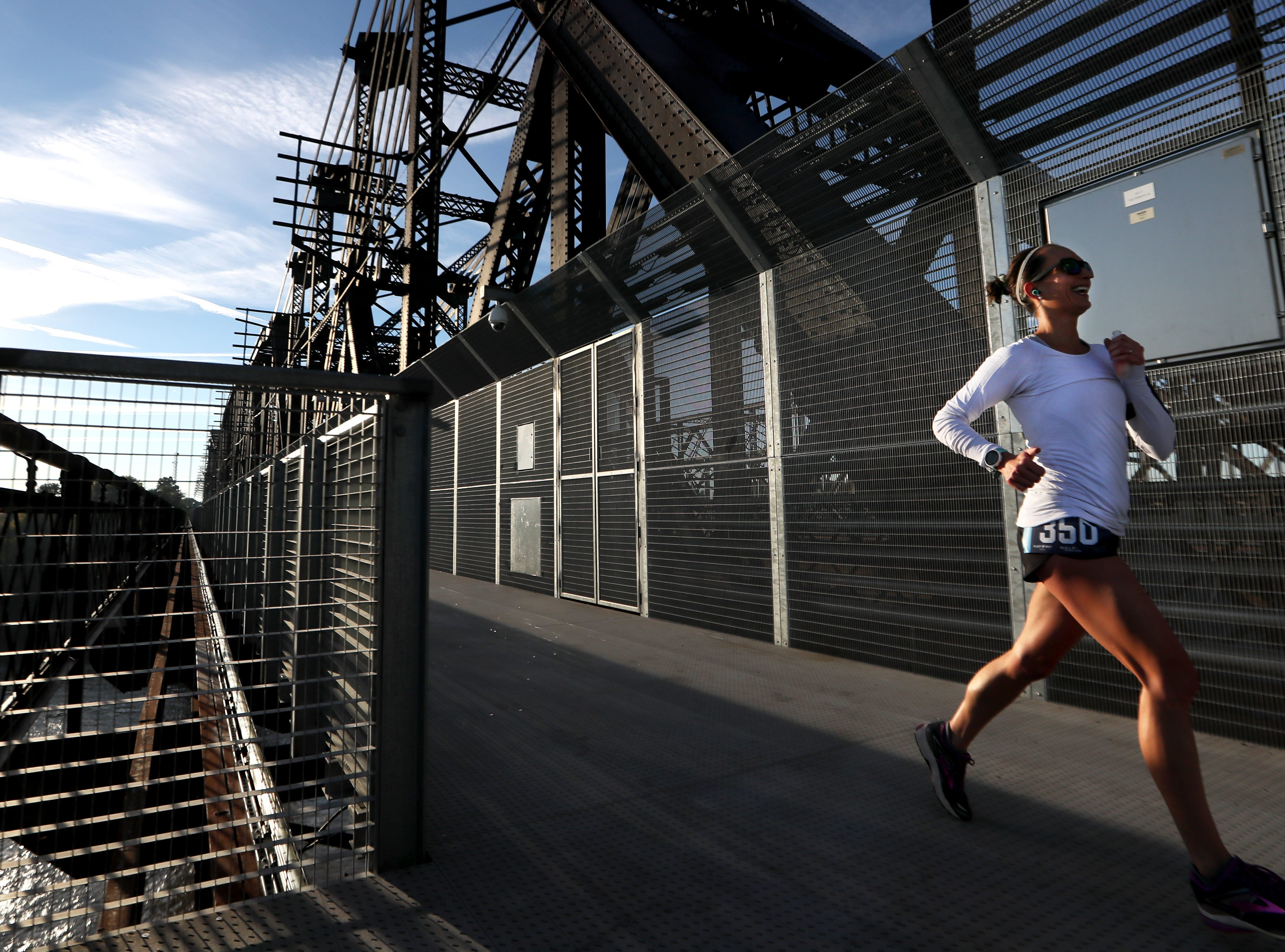 Kristina Porter crosses the state line between Tennessee and Arkansas during the Big River Crossing Half-Marathon and 5K run downtown Memphis Saturday, November 3, 2018.
