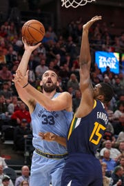 Grizzlies center Marc Gasol (33) shoots the ball past Utah Jazz forward Derrick Favors (15) during the first quarter at Vivint Smart Home Arena.
