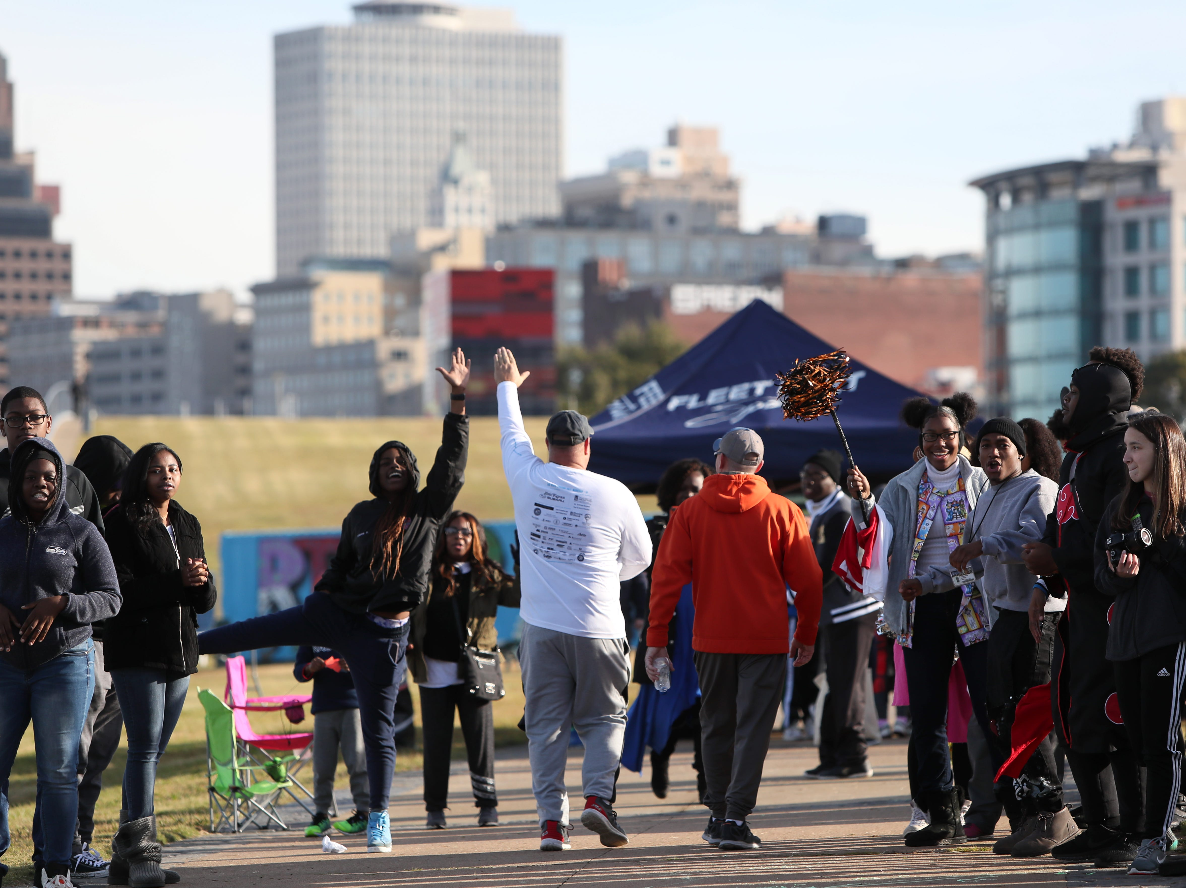 Runners are greeted at the finish line of the Big River Crossing Half-Marathon and 5K run downtown Memphis Saturday, November 3, 2018.