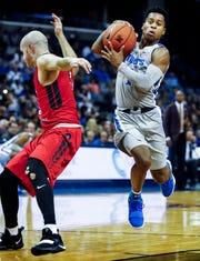 Memphis guard Tyler Harris (right) drives the lane against CBU defender Brad Miller (left) during action on Thursday.
