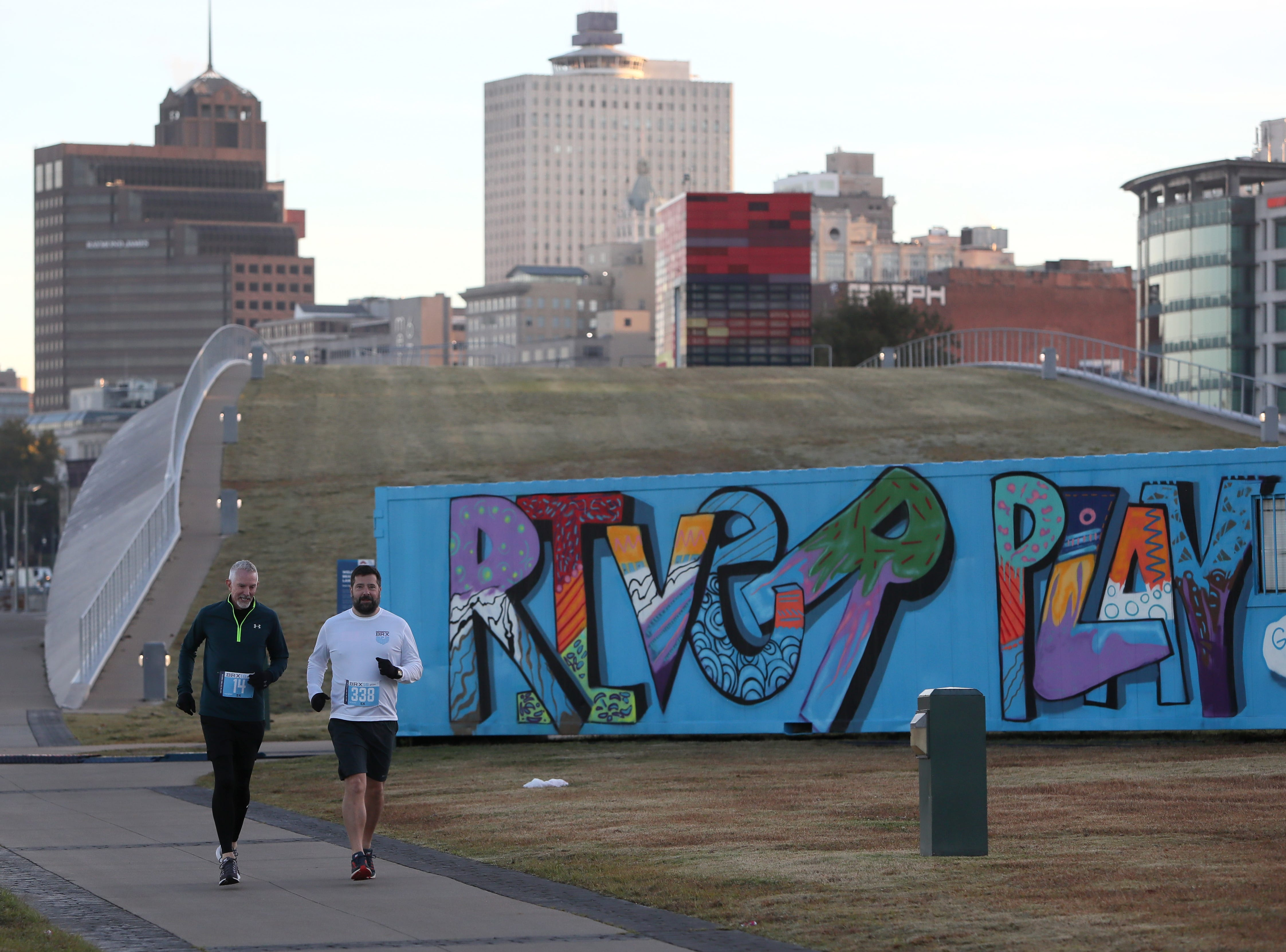Runners warm up for the Big River Crossing Half-Marathon and 5K downtown Memphis Saturday, November 3, 2018.