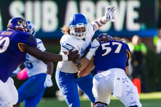 Memphis defensive lineman Jonathan Wilson tries to get around two ECU linemen during the Tigers' win at ECU on November 3, 2018