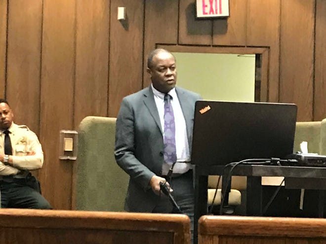 Prosecutor Reginald Henderson prepares to demonstrate for a jury how long it took Tremaine Wilbourn to fire 11 rounds, killing Memphis police officer Sean Bolton. Jury deliberations will begin Sunday. The state is seeking the death penalty.