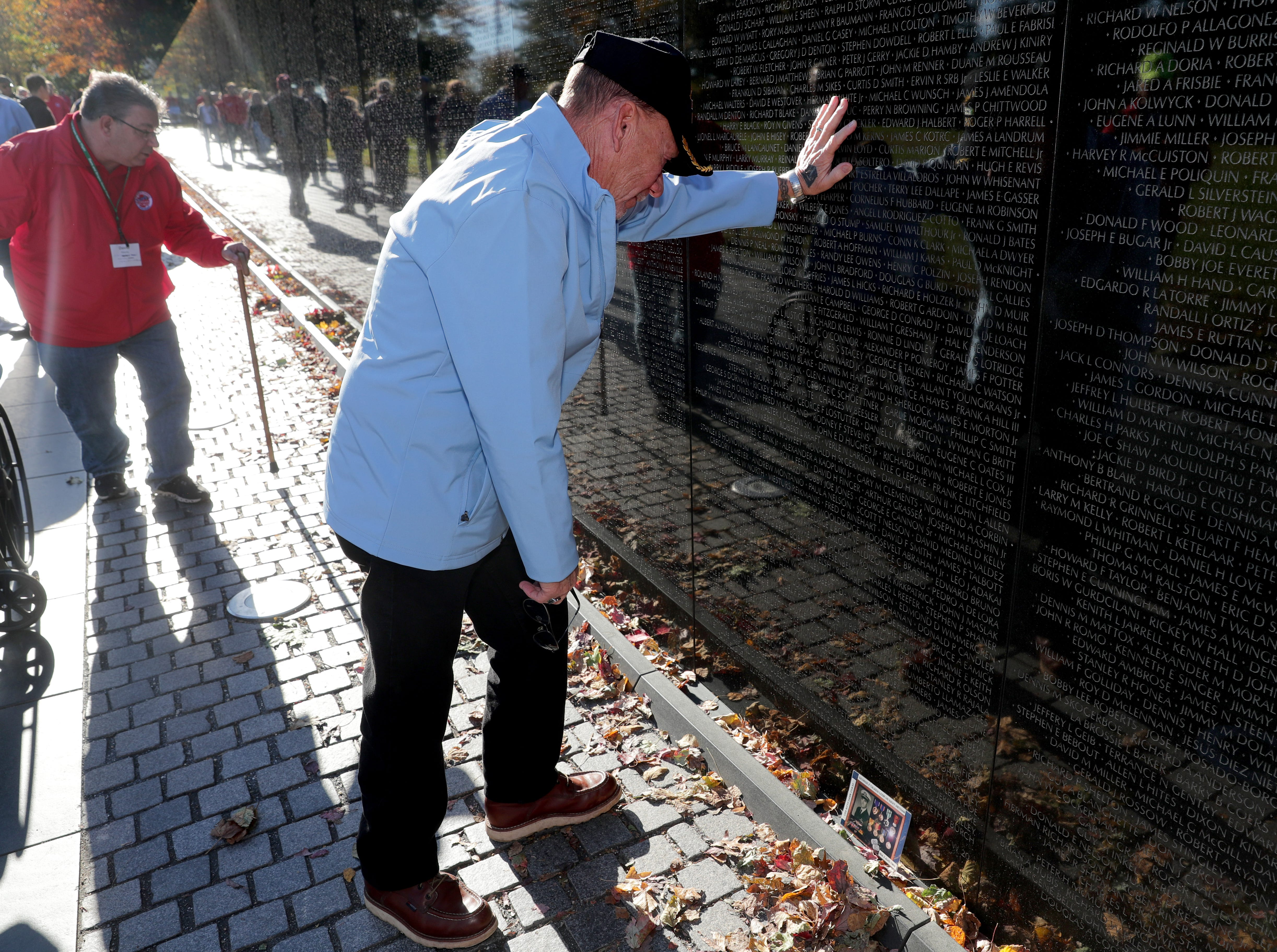 Vietnam Navy veteran Ranson Blanchard, of Elkhorn takes a moment at the Vietnam Veterans Memorial after finding his fellow Navy man's name on the wall. Following Saturday's flight, the 49th for the Honor Flight hub in southeastern Wisconsin, a total of 6,344 veterans have traveled to the nation's capital. The first flight almost exactly 10 years ago took World War II veterans to Washington, D.C.