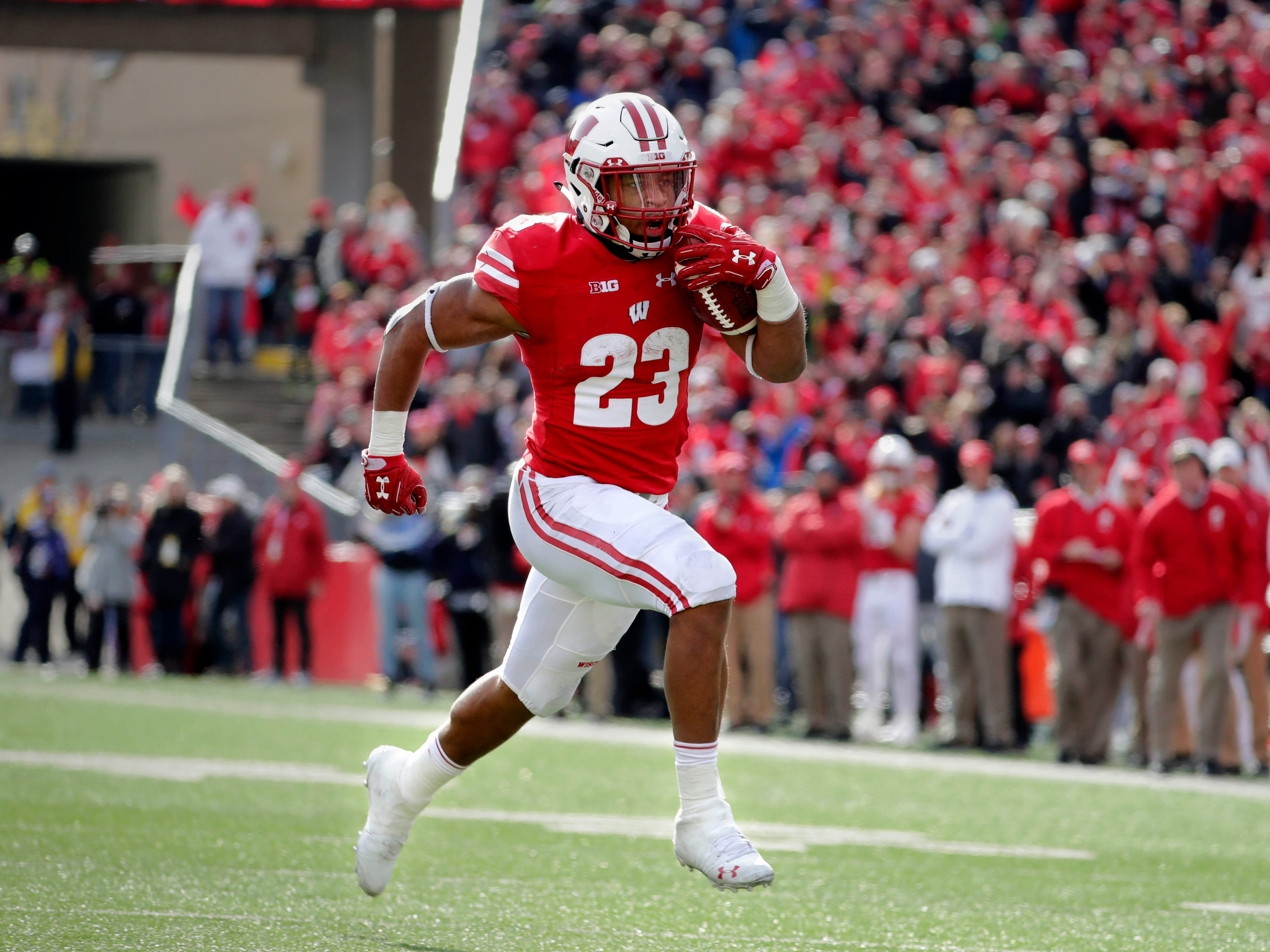 Badgers running back Jonathan Taylor finds a clear path to the end zone against Rutgers on Saturday.