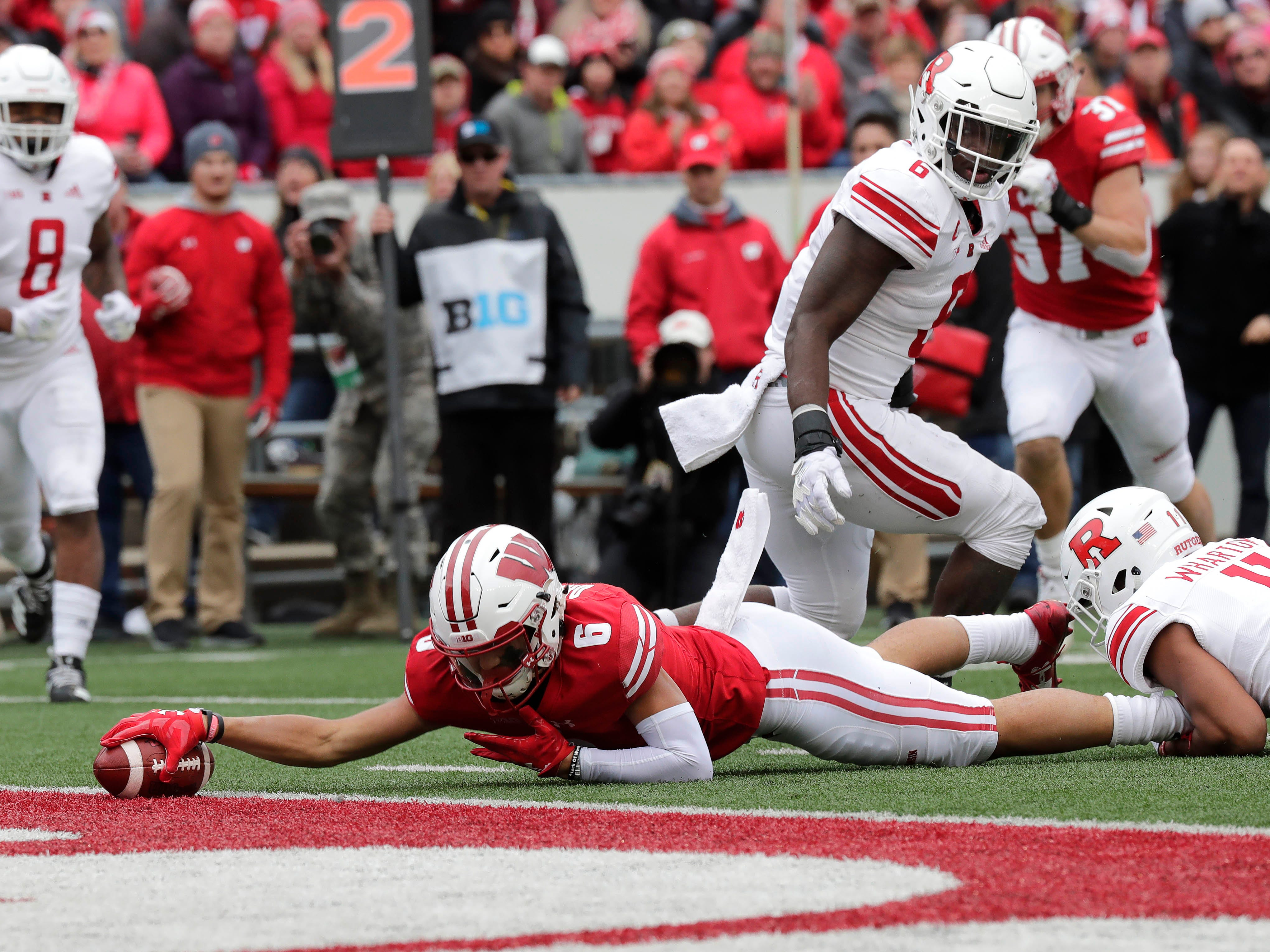 UW wide receiver Danny Davis III just breaks the plain of the goal line for a 11-yard touchdown reception against Rutgers in the fourth quarter on Saturday.