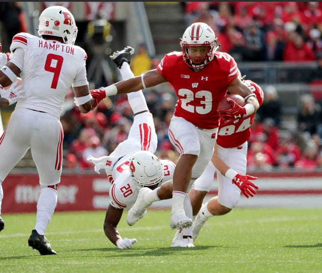 Wisconsin running back Jonathan Taylor breaks through the Rutgers defense for a touchdown during the second half on Saturday.