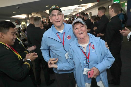 Vietnam veterans Donna and John Kleinmaus, of West Bend, after getting off the plane Saturday. The two served together in the US Army.