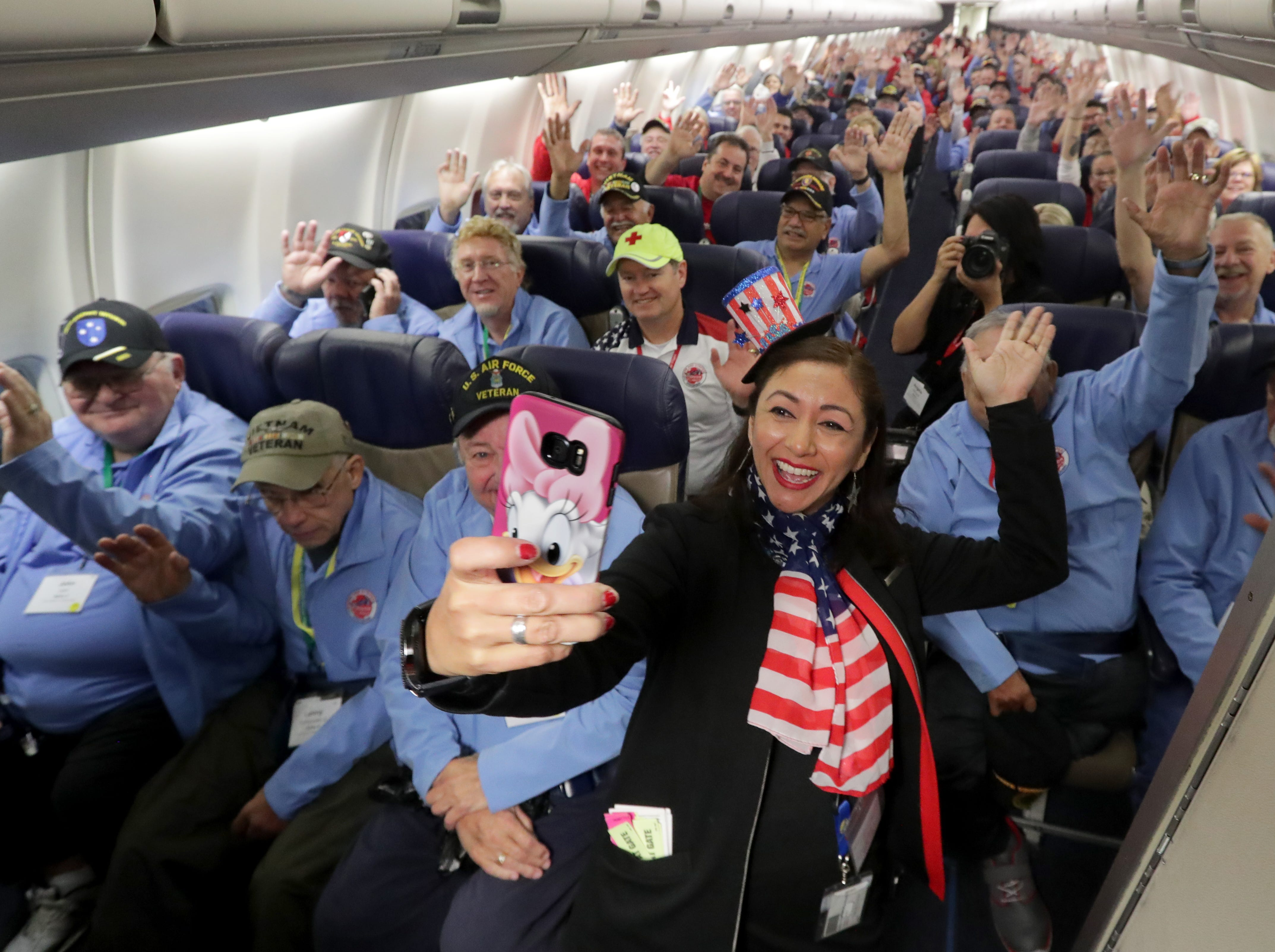 Southwest Airlines operations agent Daisy Rosas takes a selfie shortly before the plane departs in Milwaukee.