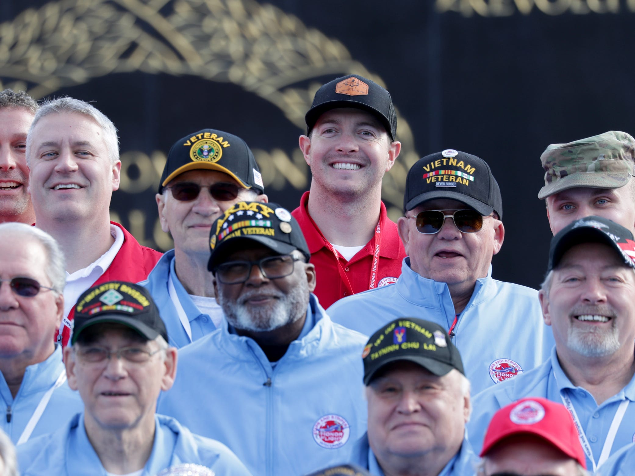 Milwaukee Brewers relief pitcher Corey Knebel (top center), who was a guardian, poses for a photo with Honor Flight veterans at the Marine Corps Memorial.