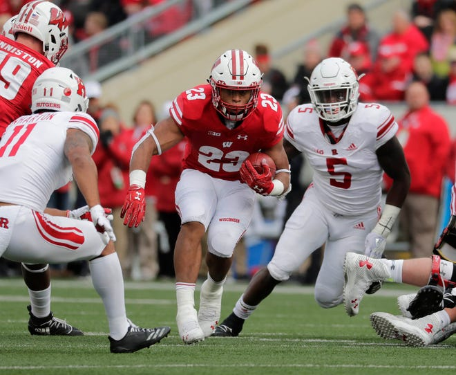 Jonathan Taylor  finished with 6,174 yards and 50 rushing touchdowns in three seasons at Wisconsin.