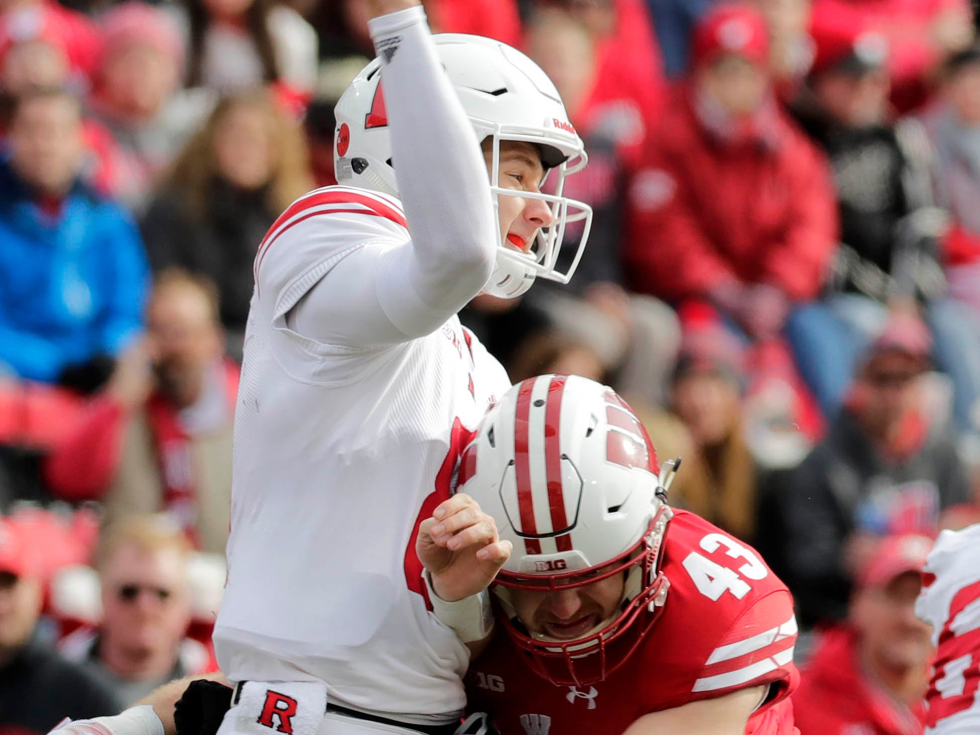 Badgers linebacker Ryan Connelly  hits Rutgers quarterback Artur Sitkowski as he gets ready to release the ball in the second half Saturday.