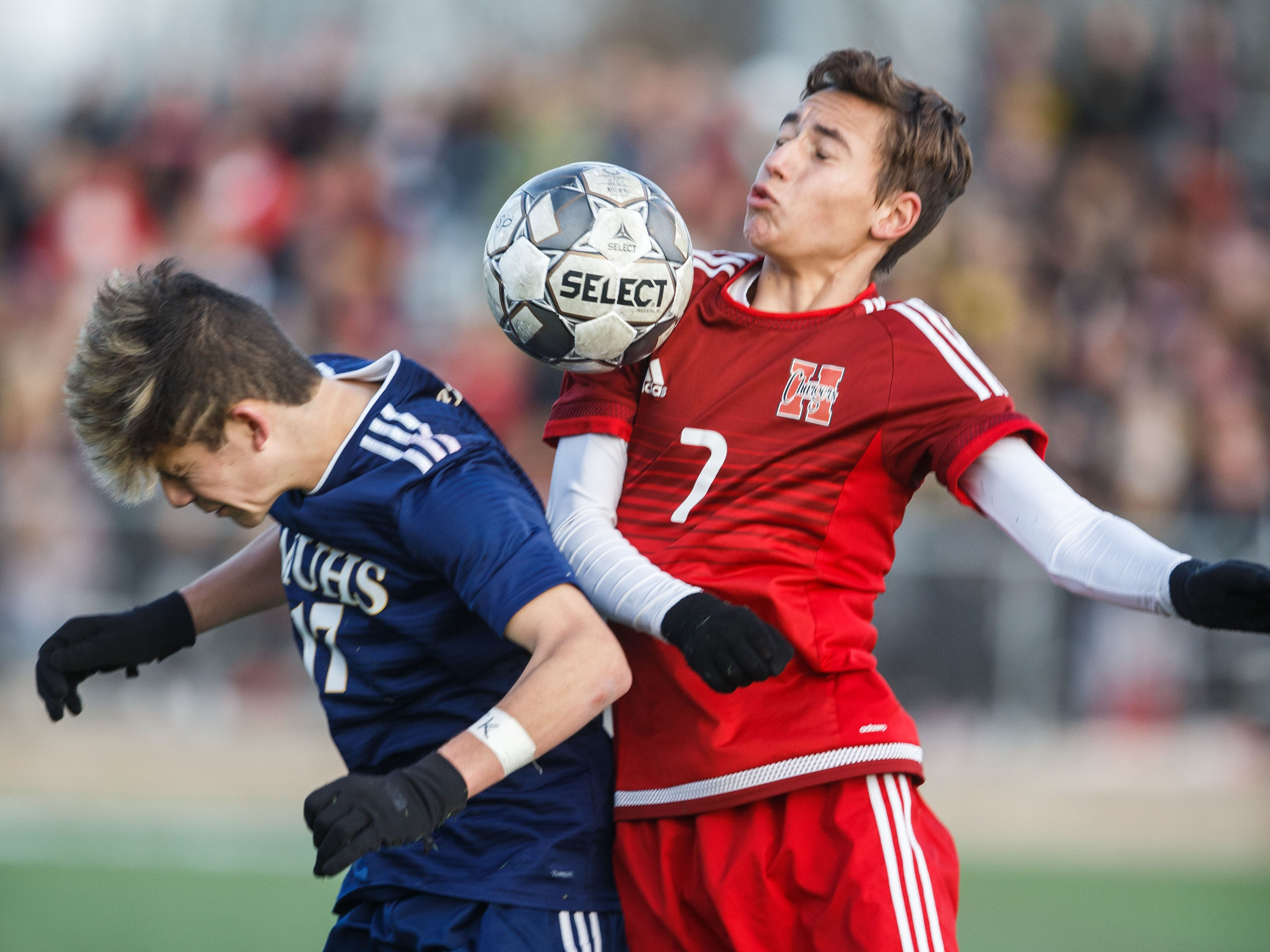 Sussex Hamilton senior Trevor Millonzi (7) battles Marquette's Gabe Anguil  for a header during the WIAA Division 1 state soccer title match on Saturday at Uihlein Soccer Park in Milwaukee.