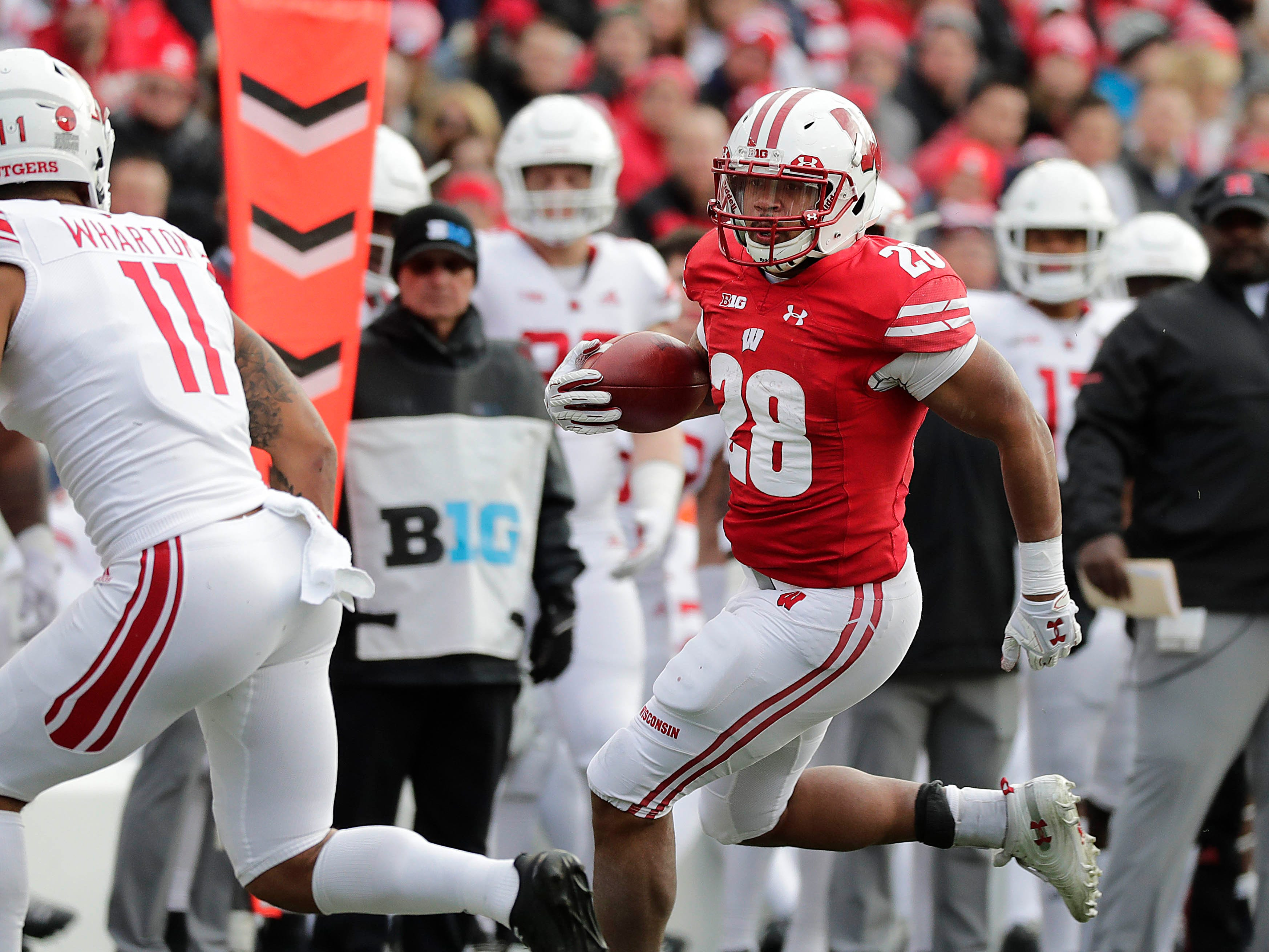 Badgers running back Taiwan Deal picks up a first down against Rutgers on Saturday.