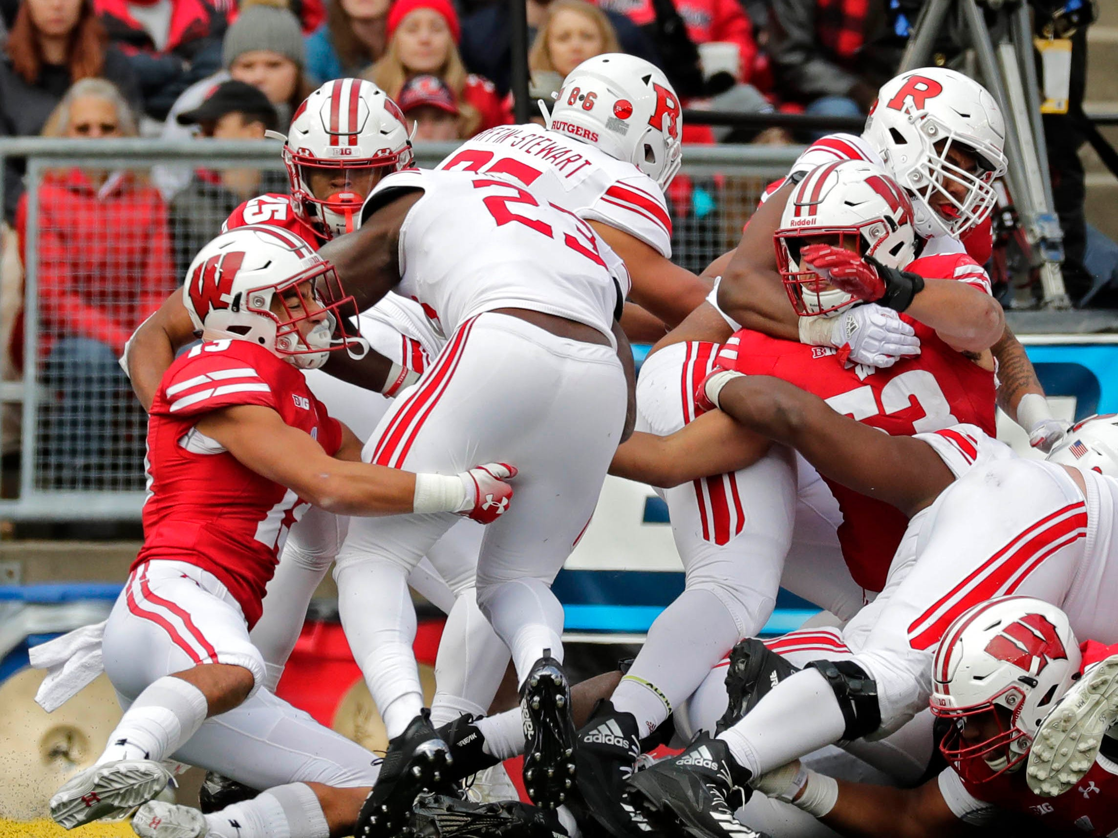 UW safety Evan Bondoc (left)  is unable to keep Rutgers running back Jonathan Hilliman from scoring a touchdown during the fourth quarter Saturday.