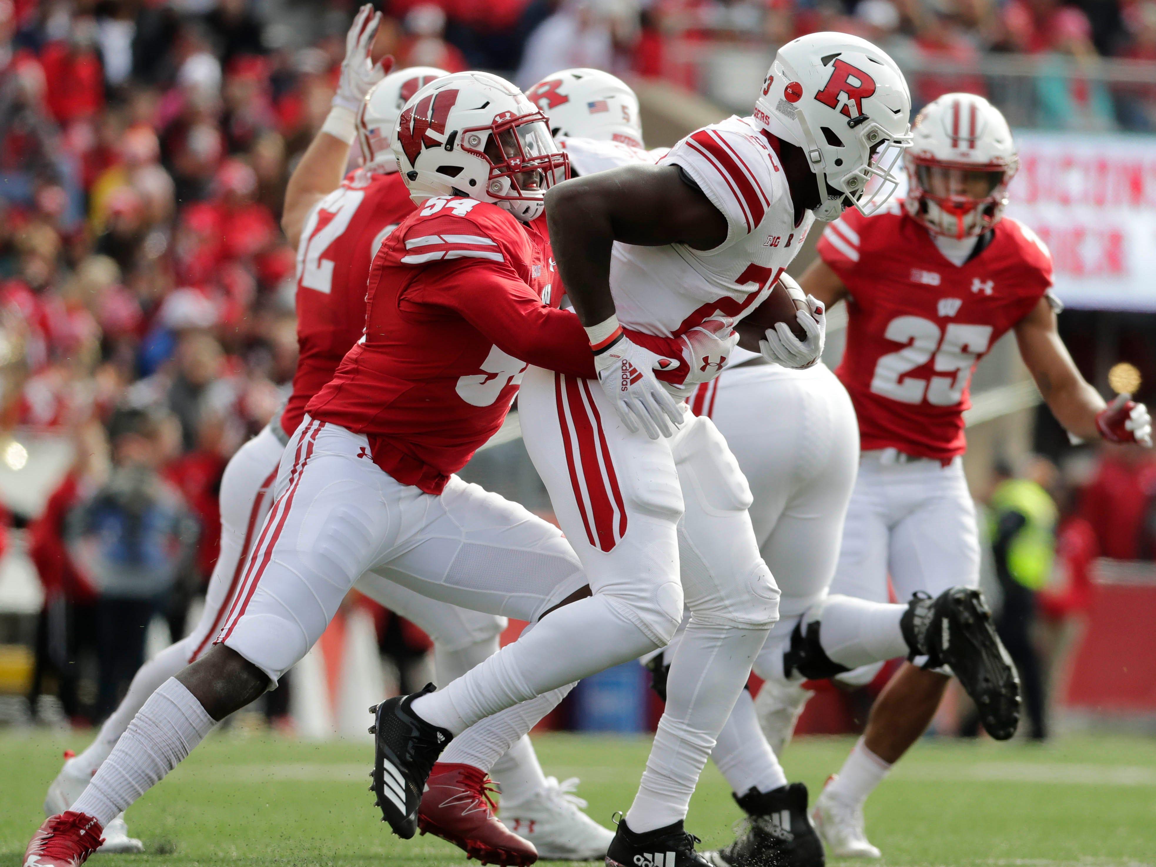 Badgers inside linebacker Chris Orr wraps up Rutgers running back Jonathan Hilliman on Saturday.