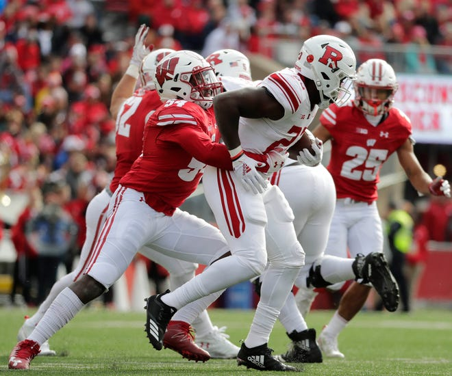Badgers inside linebacker Chris Orr, shown wrapping up Rutgers' Jonathan Hilliman, has 19 tackles this season, 17 fewer than he had in 12 games last year.