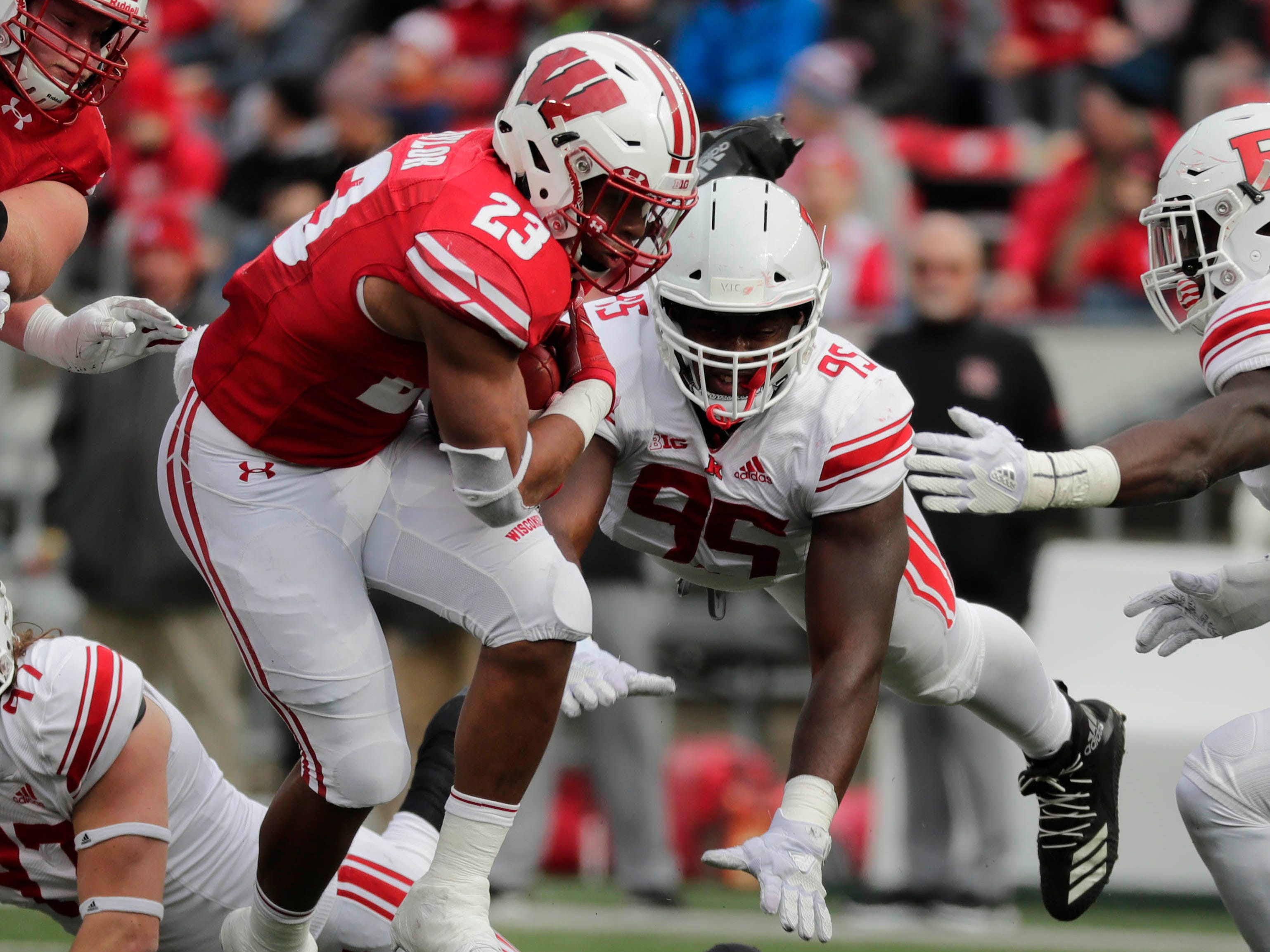 Badgers running back Jonathan Taylor picks ups 6 yards on first down against Rutgers during the the first half Saturday.