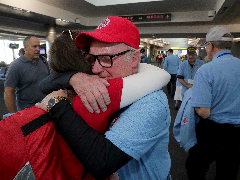 Wayne Sander of Dousman is overcome as he hugs his daughter, Tara Sander Lee of Brookfield, at the Baltimore Airport. Sander, a Vietnam veteran, served in teh Marines.