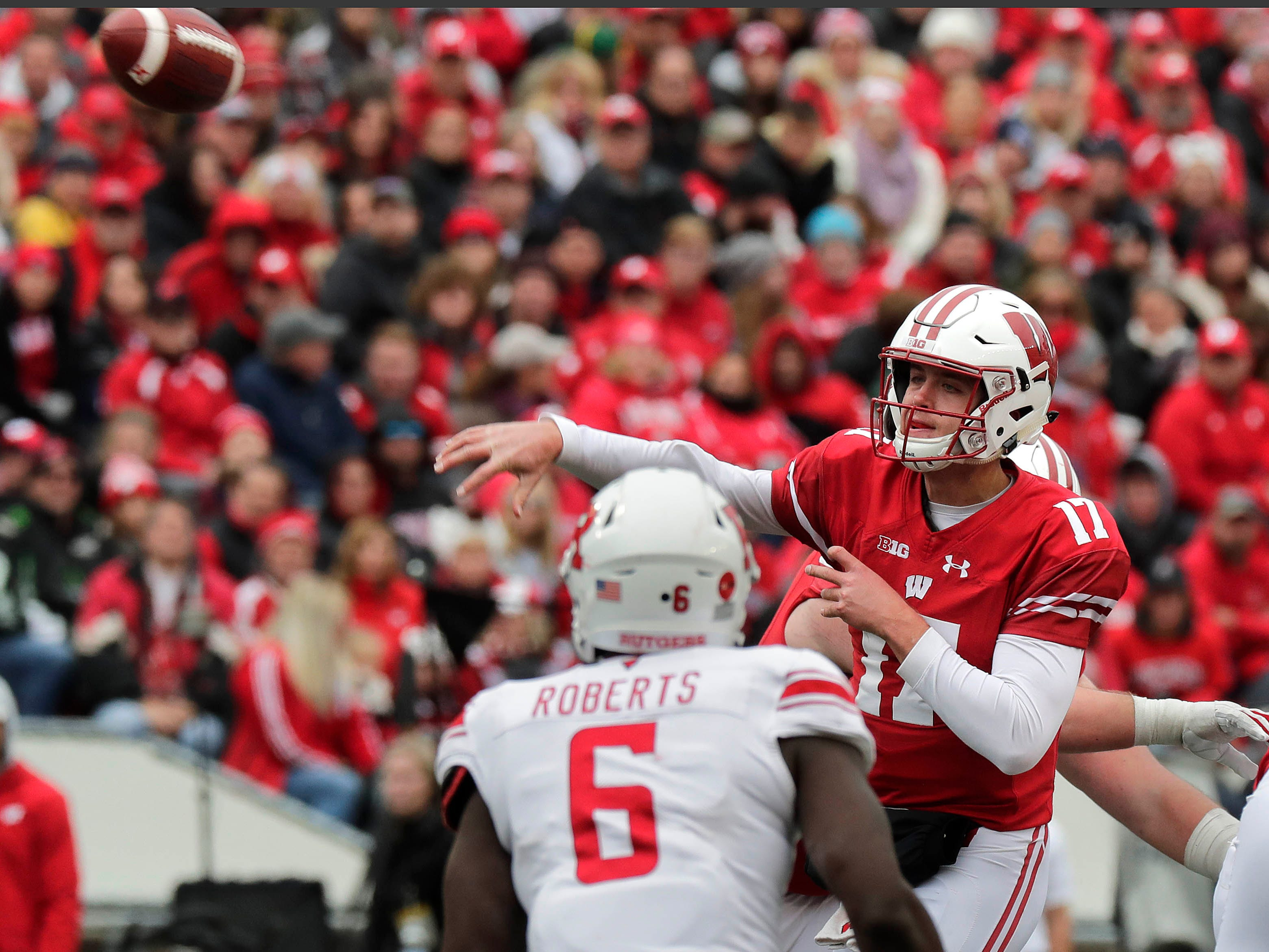 UW quarterback Jack Coan completes a pass against Rutgers during the second half on Saturday.