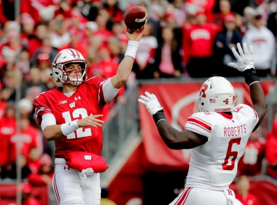 Badgers quarterback Alex Hornibrook throws an ill-advised pass that is eventually picked off by Rutgers defensive back Saquan Hampton (not pictured) in the firstst quarter Saturday.