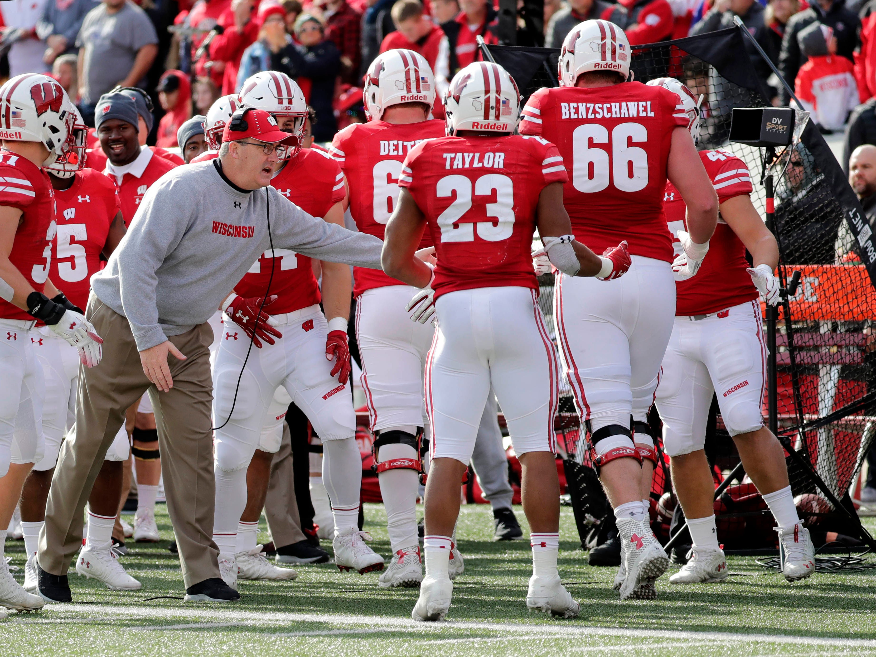 UW coach Paul Chryst congratulates Jonathan Taylor after the running back scored a touchdown against Rutgers on Saturday.