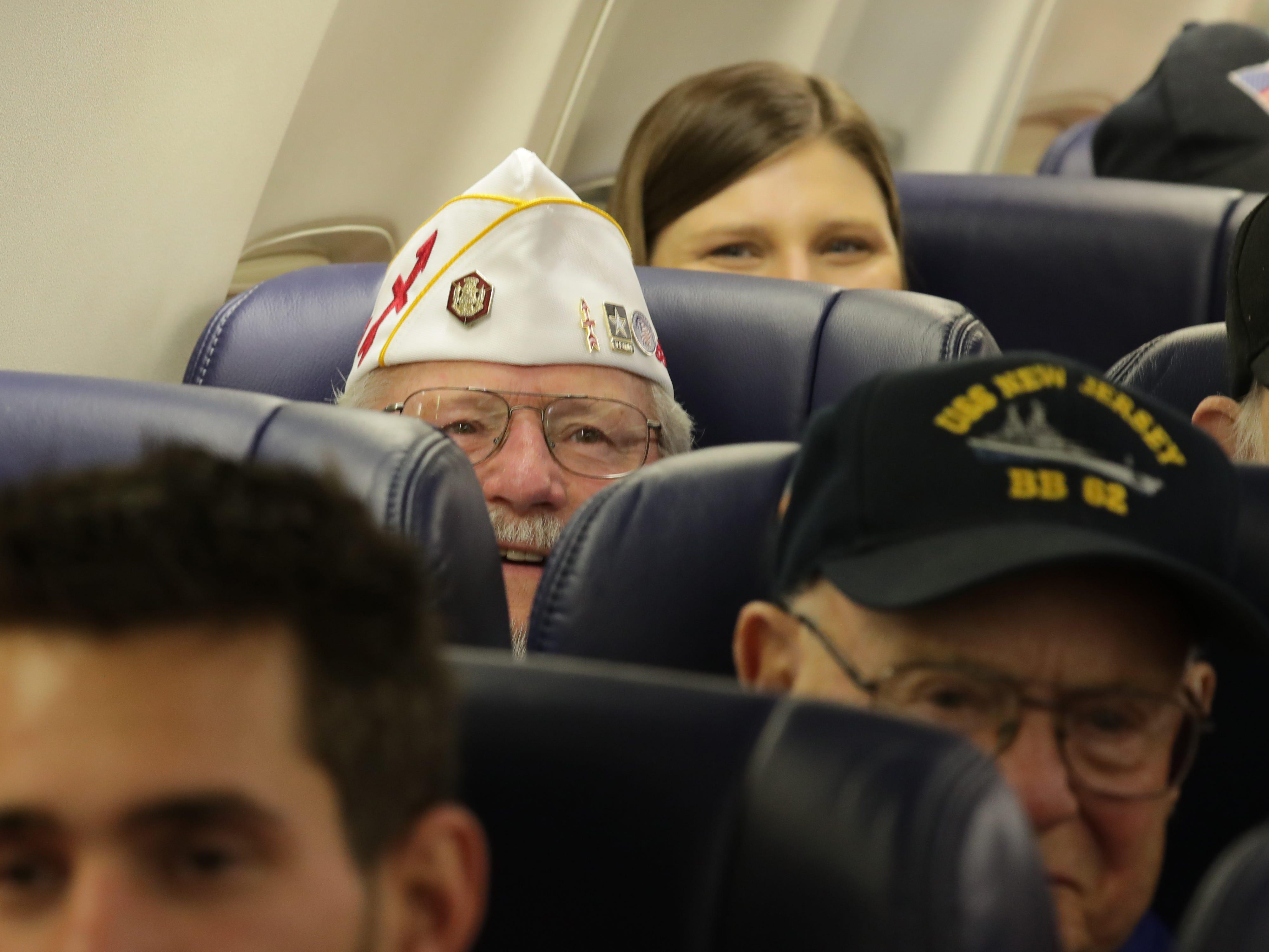 Vietnam veteran Gus Totsky peers over the seat before takeoff.