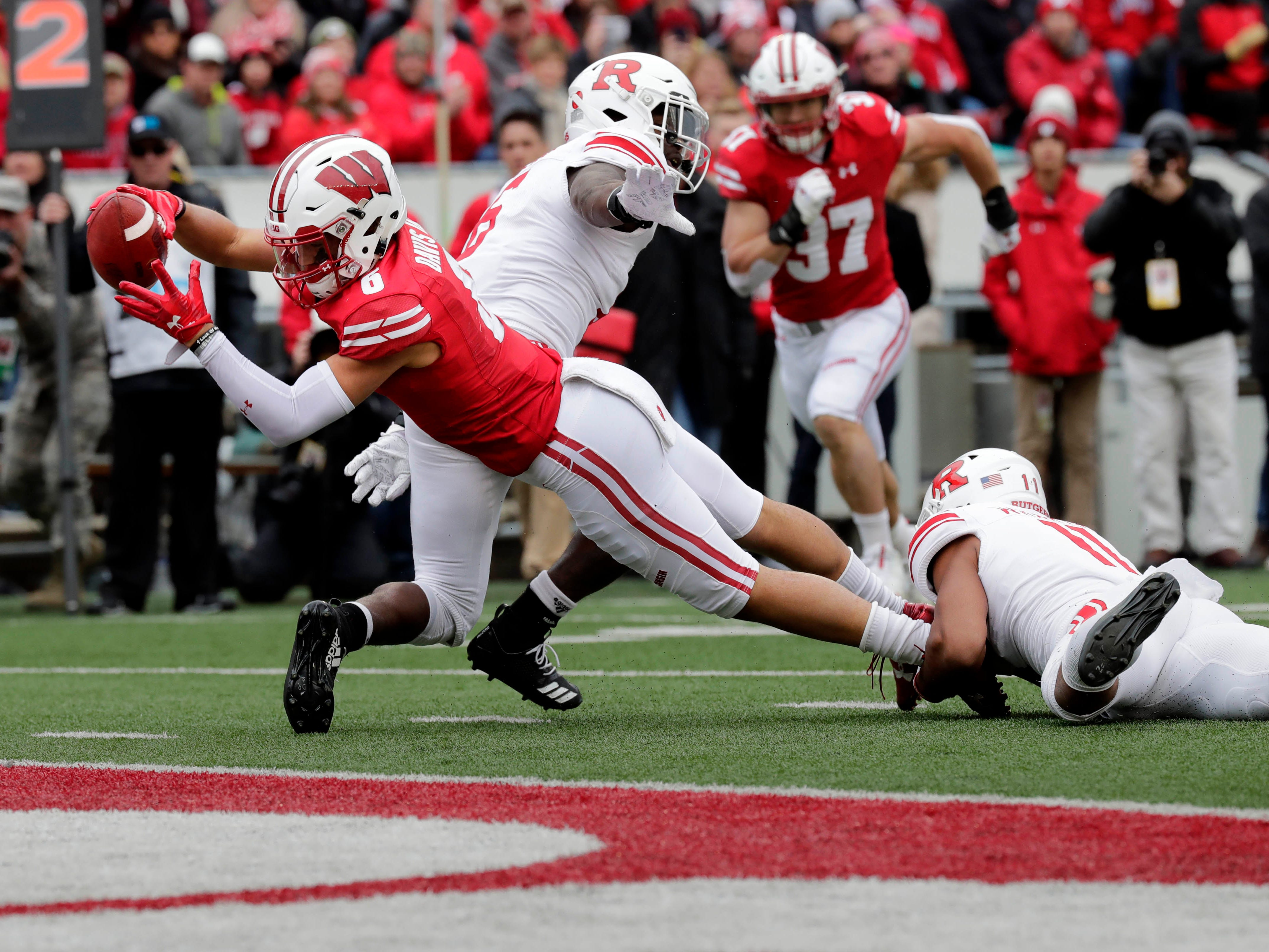 Badgers wide receiver Danny Davis III  stretches for the end zone against Rutgers in the fourth quarter on Saturday.