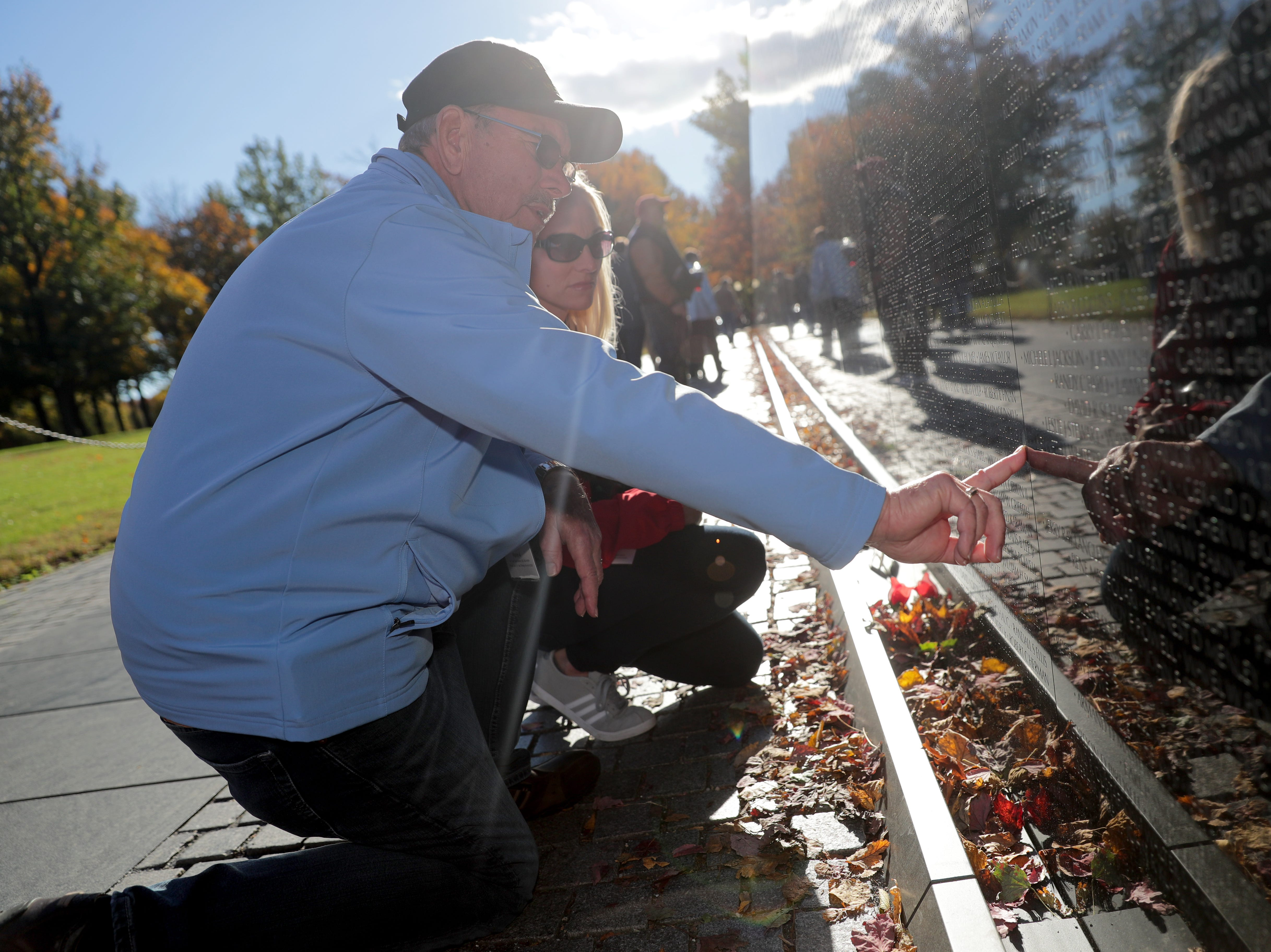 Vietnam Navy veteran Wally Beck, from Norwalk, Wisconsin, looks up a neighbor's name at the Vietnam Veterans Memorial while with his Honor Flight guardian, daughter Cathy Berrall of Sussex.