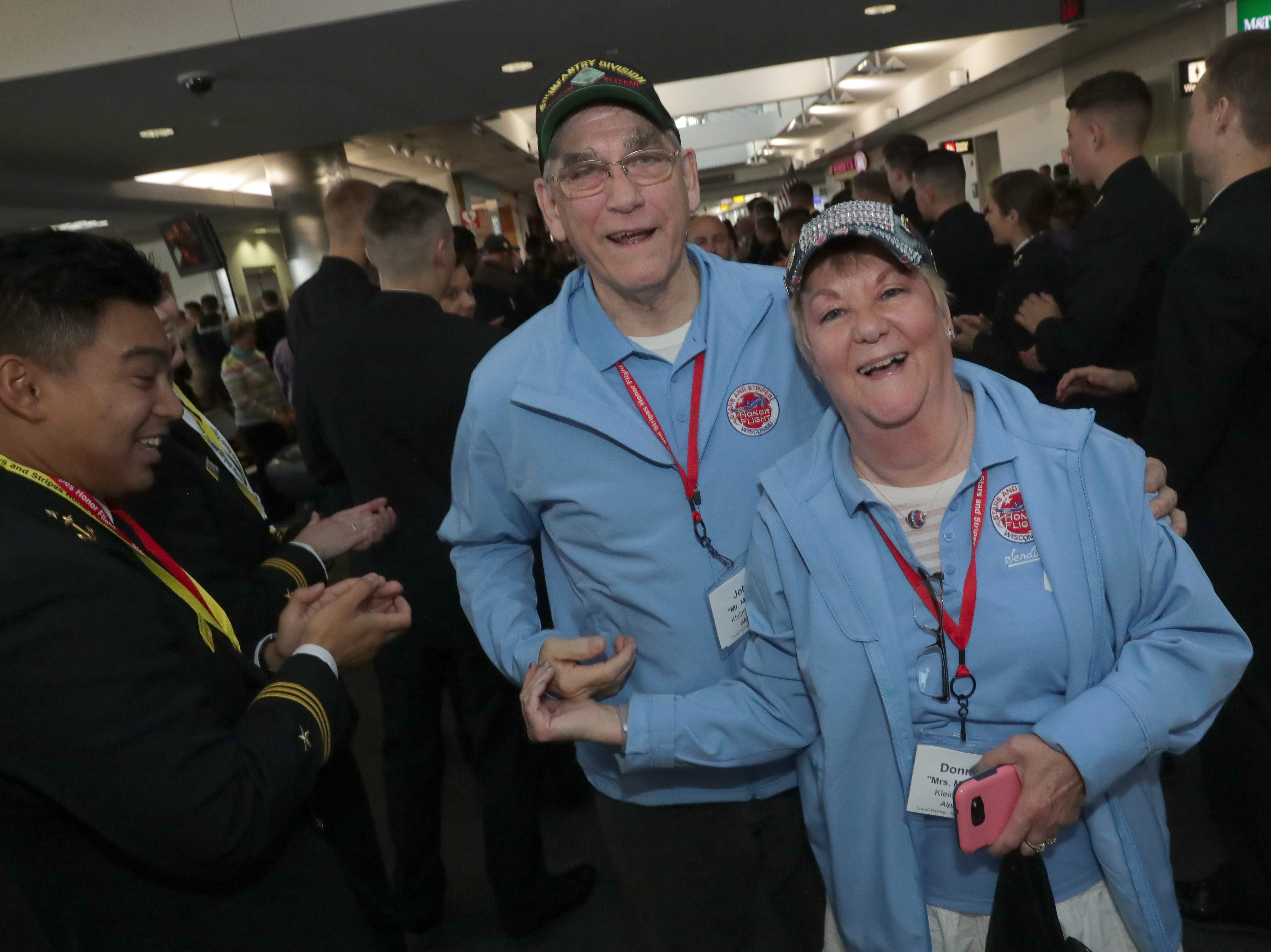 Vietnam veterans Donna Kleinmaus and her husband, John, of West Bend, smile at the greeting they received. The two served together in the U.S. Army.