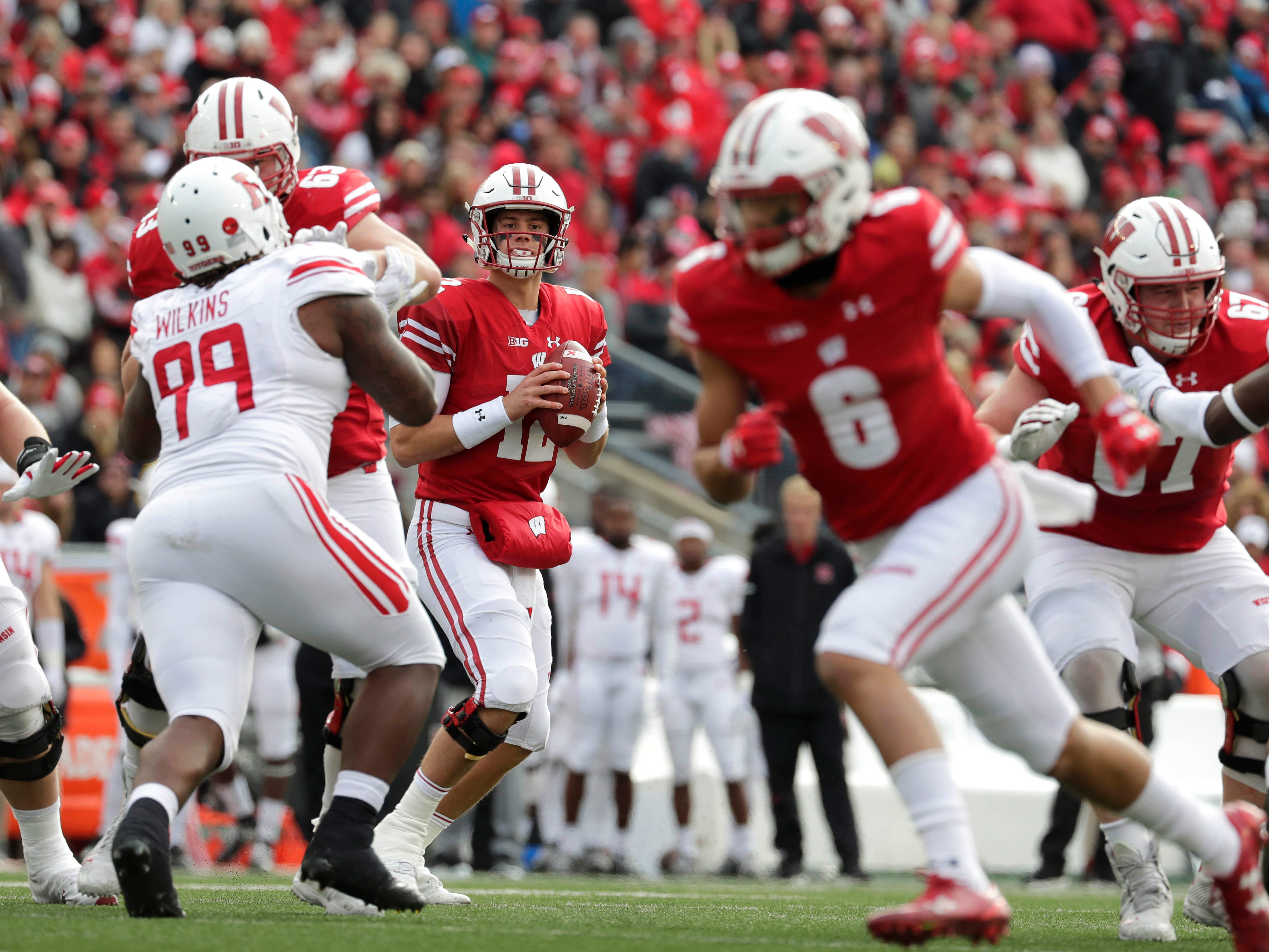 Badgers quarterback Alex Hornibrook looks for an open receiver in the red zone during the first half against Rutgers on Saturday.