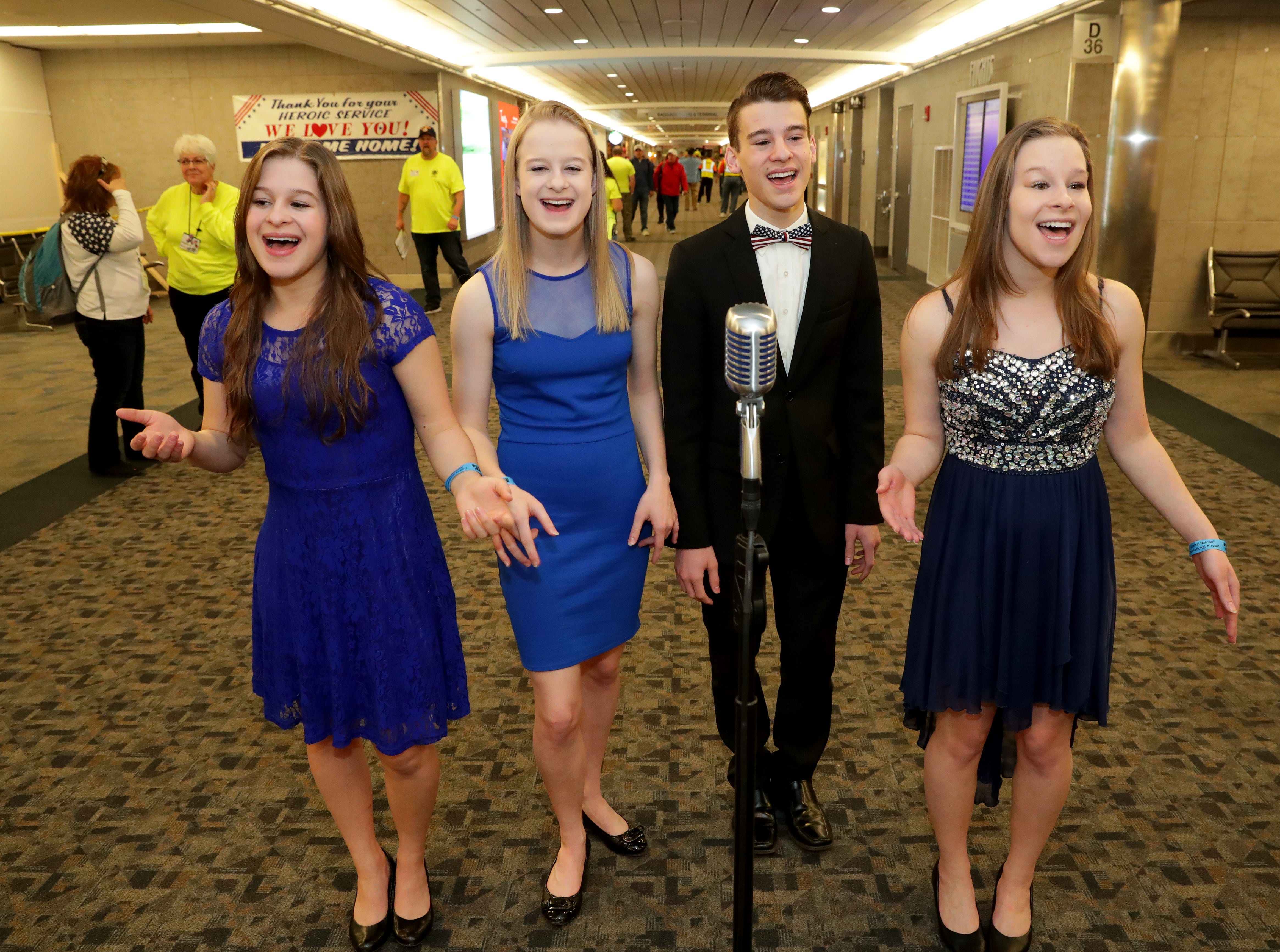 The quadruplet quartet singing group Vintage Mix from Waukesha sent off the veterans with a performance. The singers are Julia Shoppach (from left), Anika Shoppach, Ian Shoppach, and Kelsey Shoppach. The family has been performing for honor flight sendoffs since 2014.