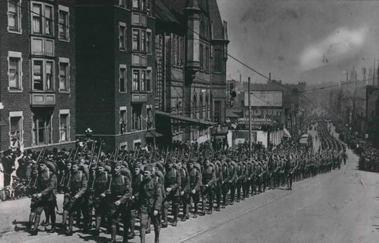 Troops march through Milwaukee after returning from the fighting in Europe during the First World War.