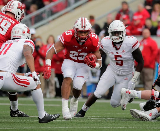 Wisconsin Badgers running back Jonathan Taylor (23) picks up 7 yards on first down in the 1st half during the Big Ten football game against Rutgers at Camp Randall  in Madison, Wisconsin  Saturday, November 3, 2018. - Photo by Rick Wood / Milwaukee Journal. RICK WOOD/MILWAUKEE JOURNAL SENTINEL