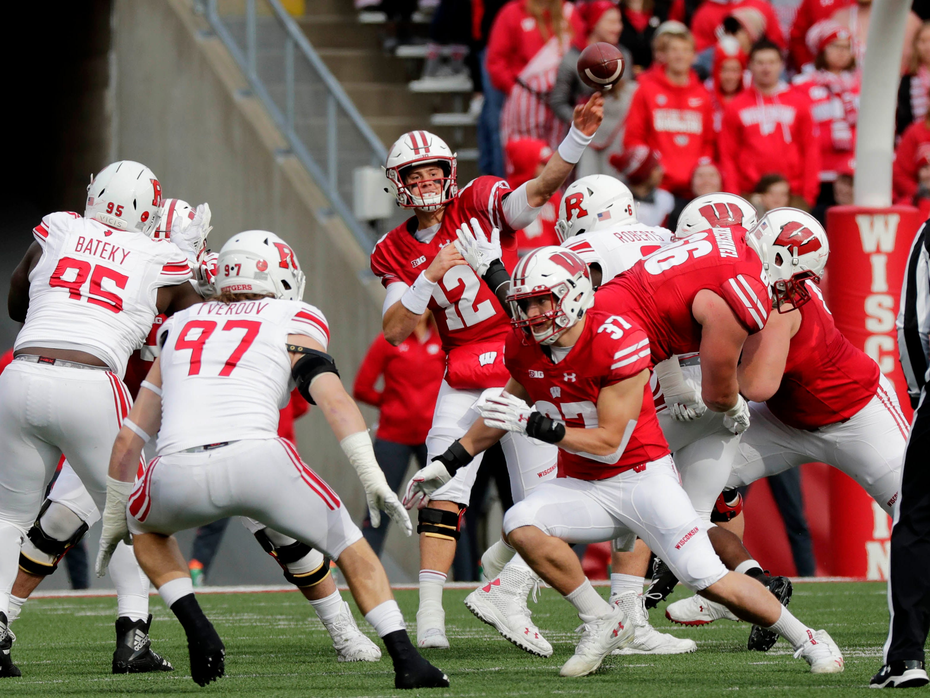 Wisconsin quarterback Alex Hornibrook unleashes a pass the tight end Jake Ferguson (not pictured) will catch for a first down against Rutgers on Saturday.