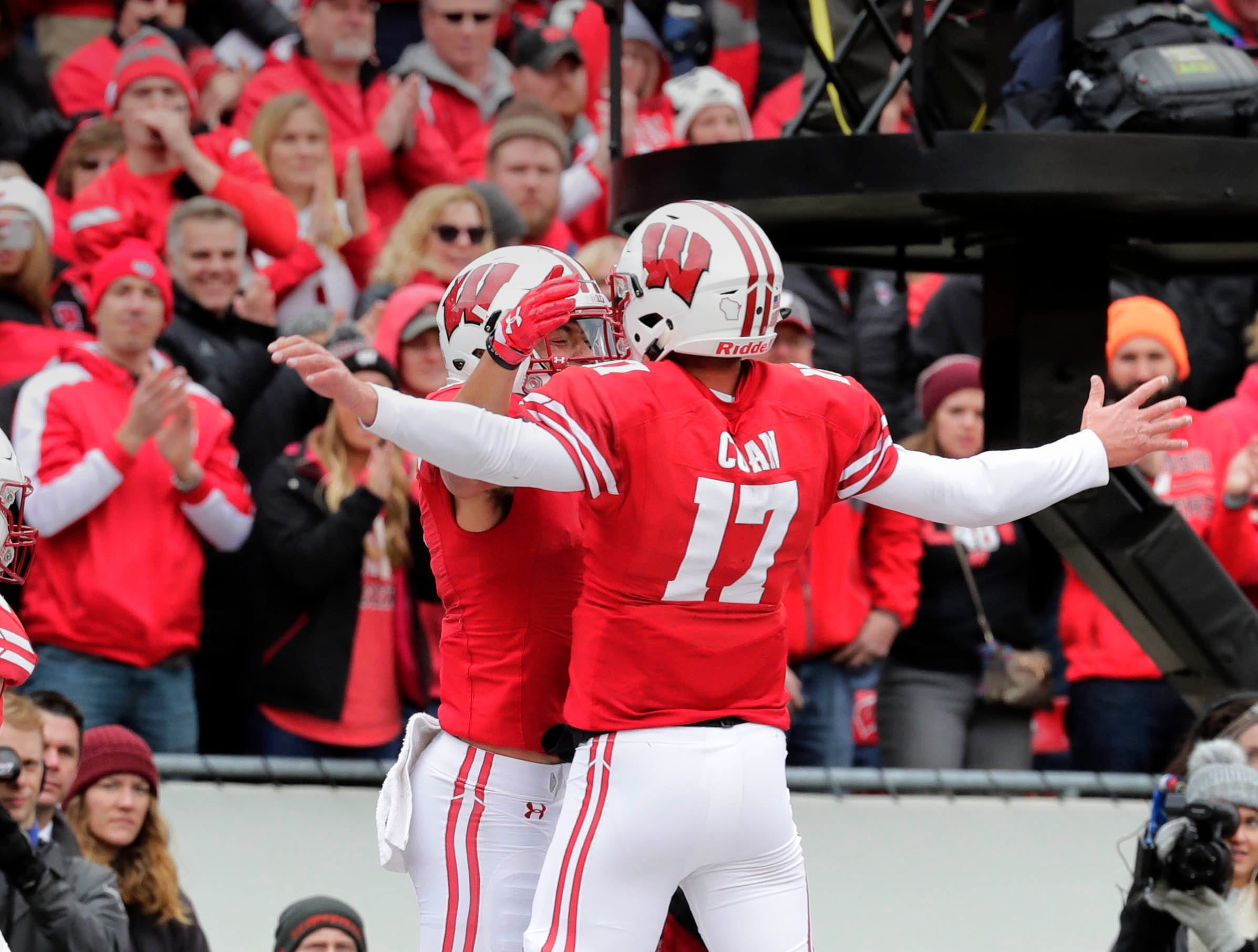 Badgers wide receiver Danny Davis III (left) and quarterback Jack Coan celebrate after the two hooked up for an 11-yard touchdown reception during the fourth quarter on Saturday.