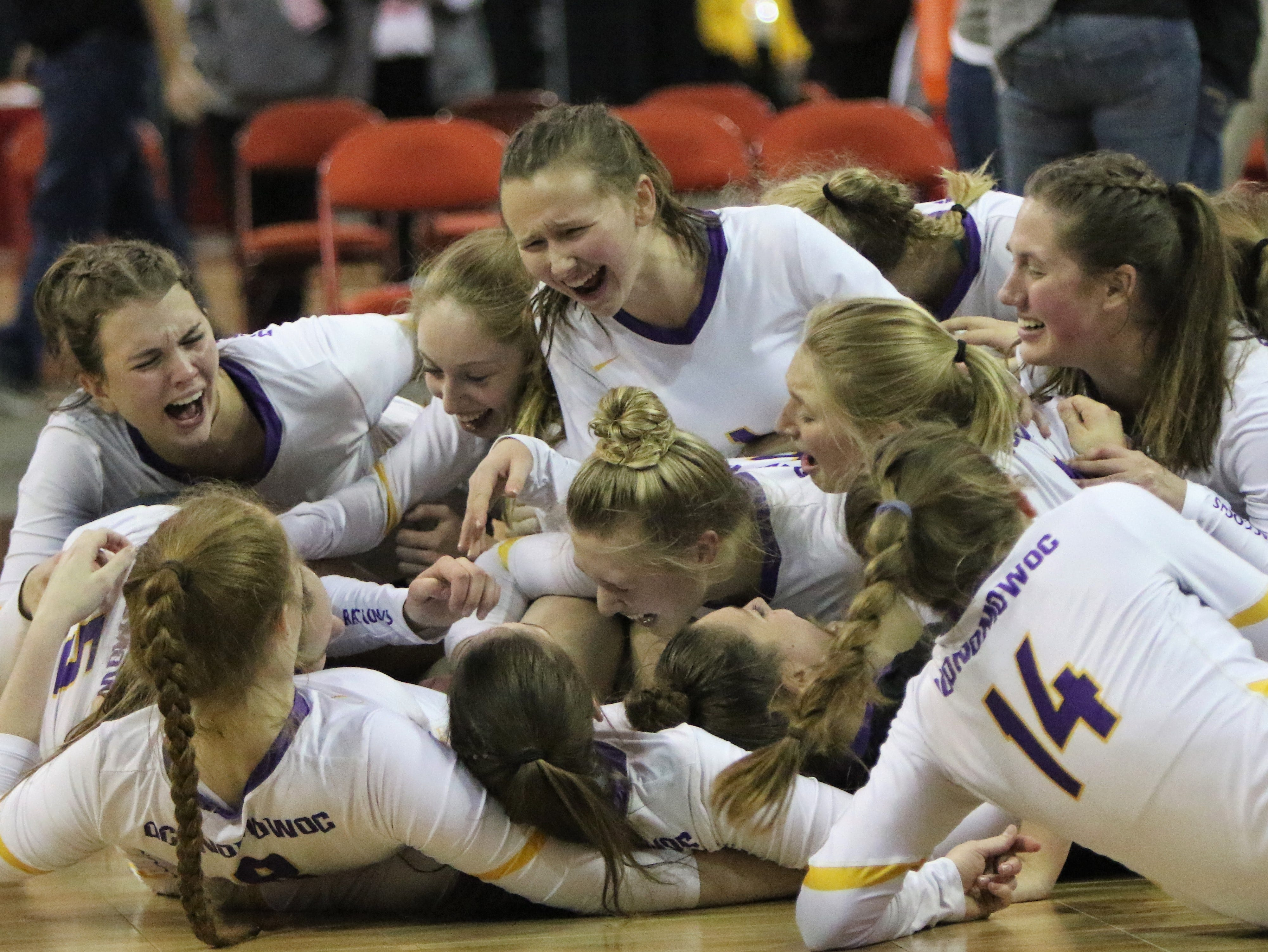 Oconomowoc girls volleyball celebrates its comeback win over River Falls in a Division 1 semifinal on Friday.