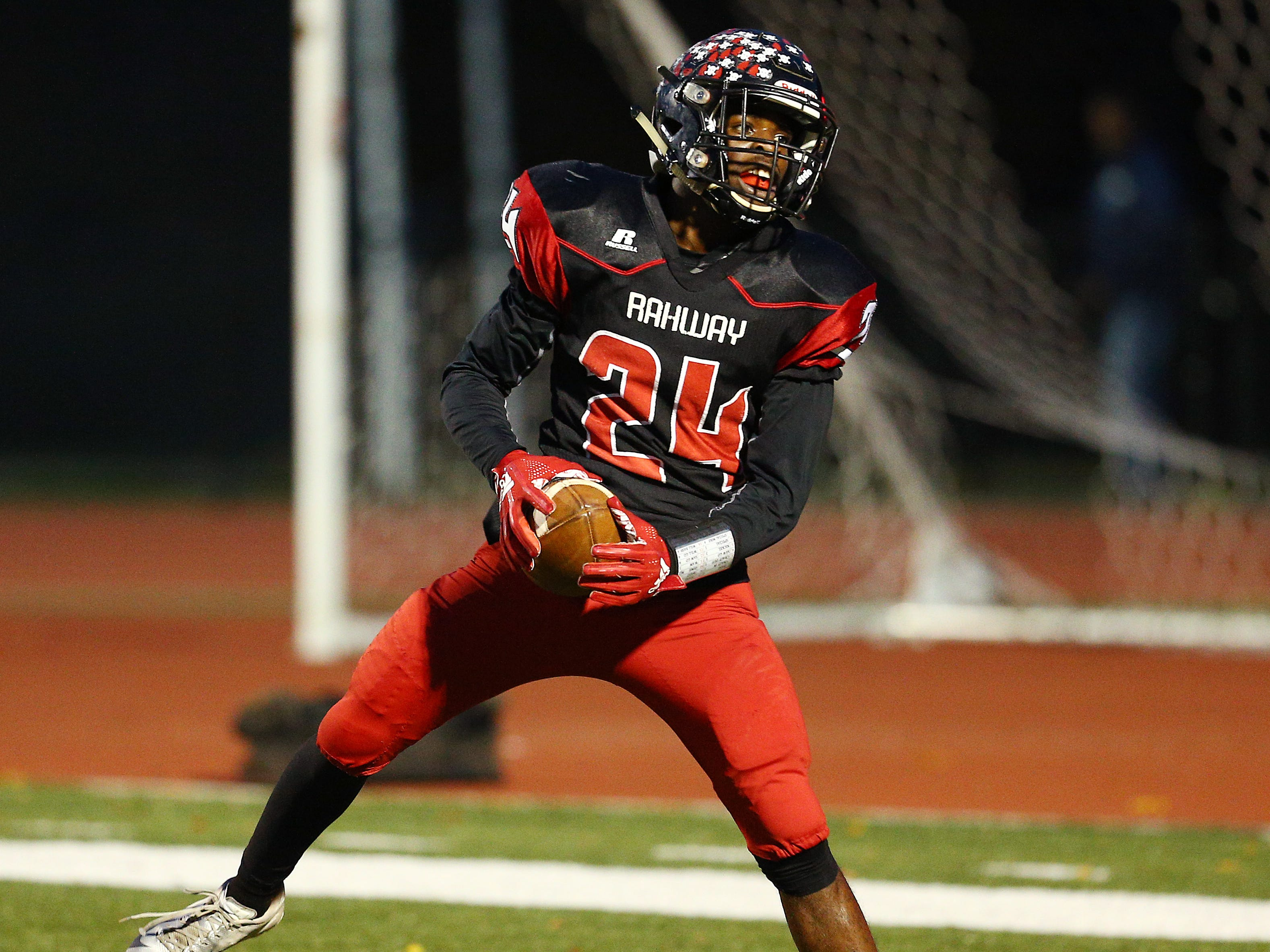 Rahway's Zi'on Pendleton celebrates a first half touchdown vs. Parsippany Hills during their NJSIAA North 2 Group III football quarterfinal at Rahway River Park. November 2, 2018, Rahway, NJ