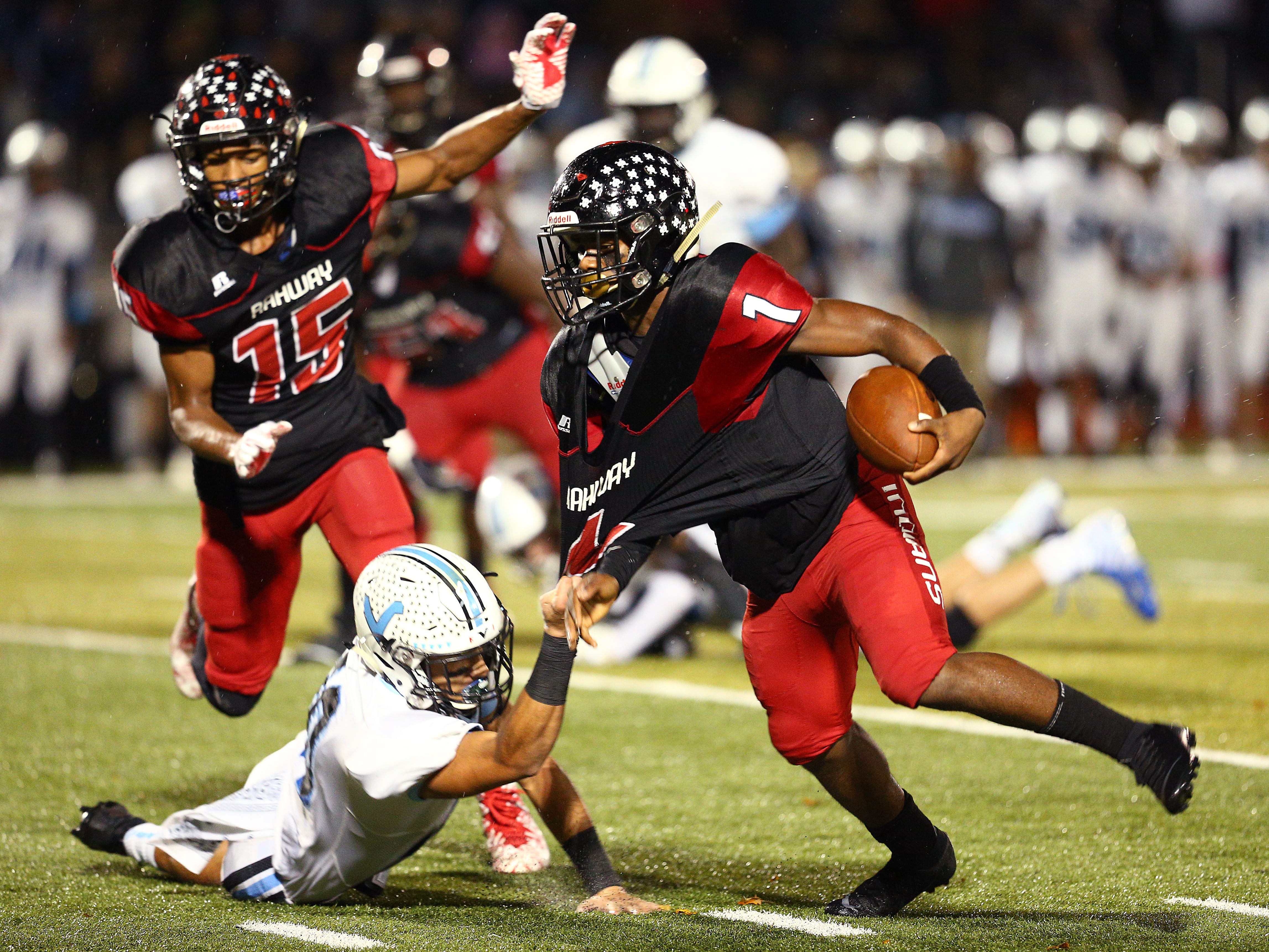 Parsippany Hills Jayson Marte hangs on to Rahway running back Da'Shon Moore during their NJSIAA North 2 Group III football quarterfinal at Rahway River Park. November 2, 2018, Rahway, NJ