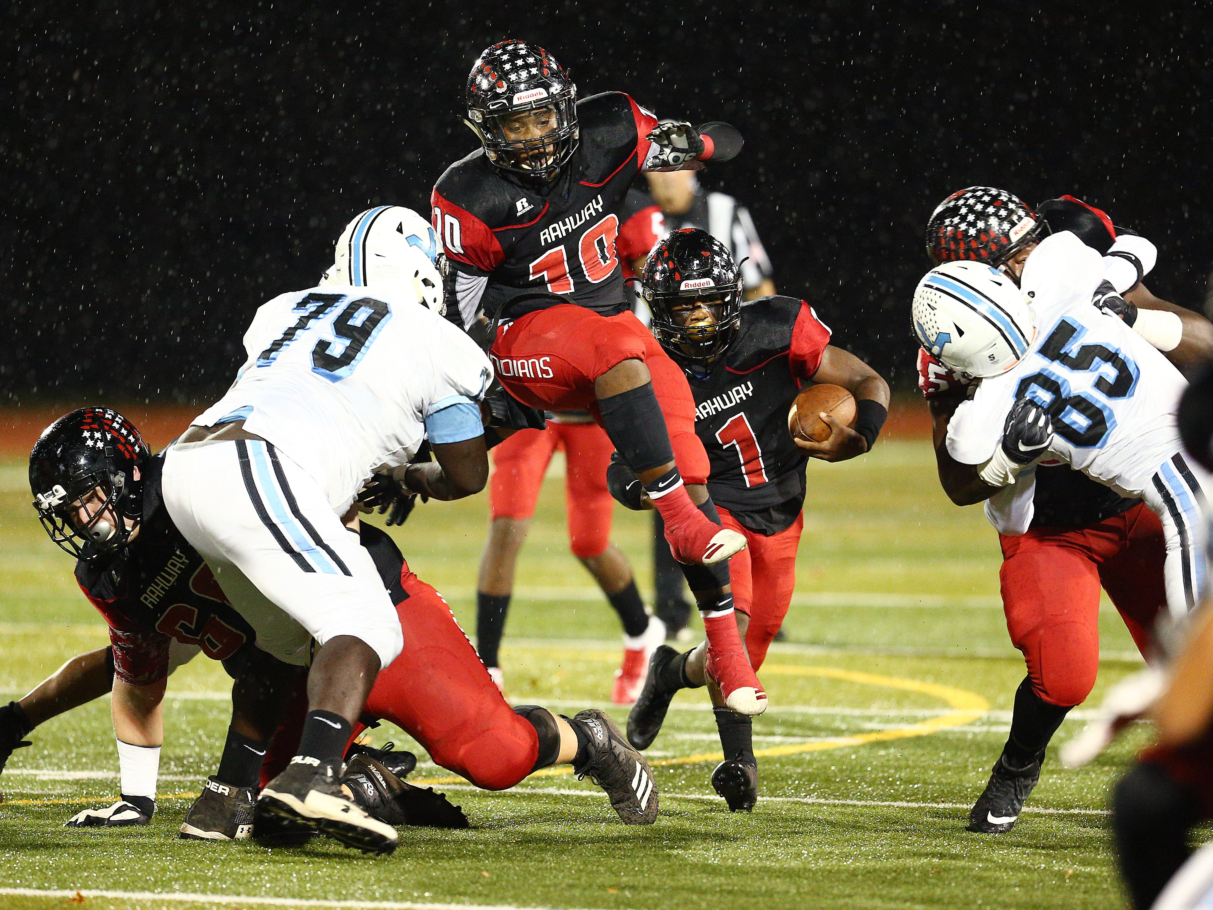 Rahway's Jalen Bateman goes airborne to block for running back Da'Shon Moore vs. Parsippany Hills during their NJSIAA North 2 Group III football quarterfinal at Rahway River Park. November 2, 2018, Rahway, NJ