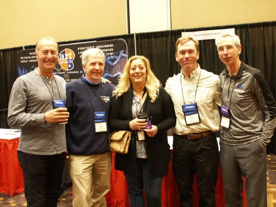 Local representation at the trade show: Rich Mark, Walt Wormann (Oakwood Lanes), Dori Tingoli, Rob Plenge and Tom Laskow. Laskow is a local bowler, coach and was an exhibitor for Avatar telecom and energy solutions.