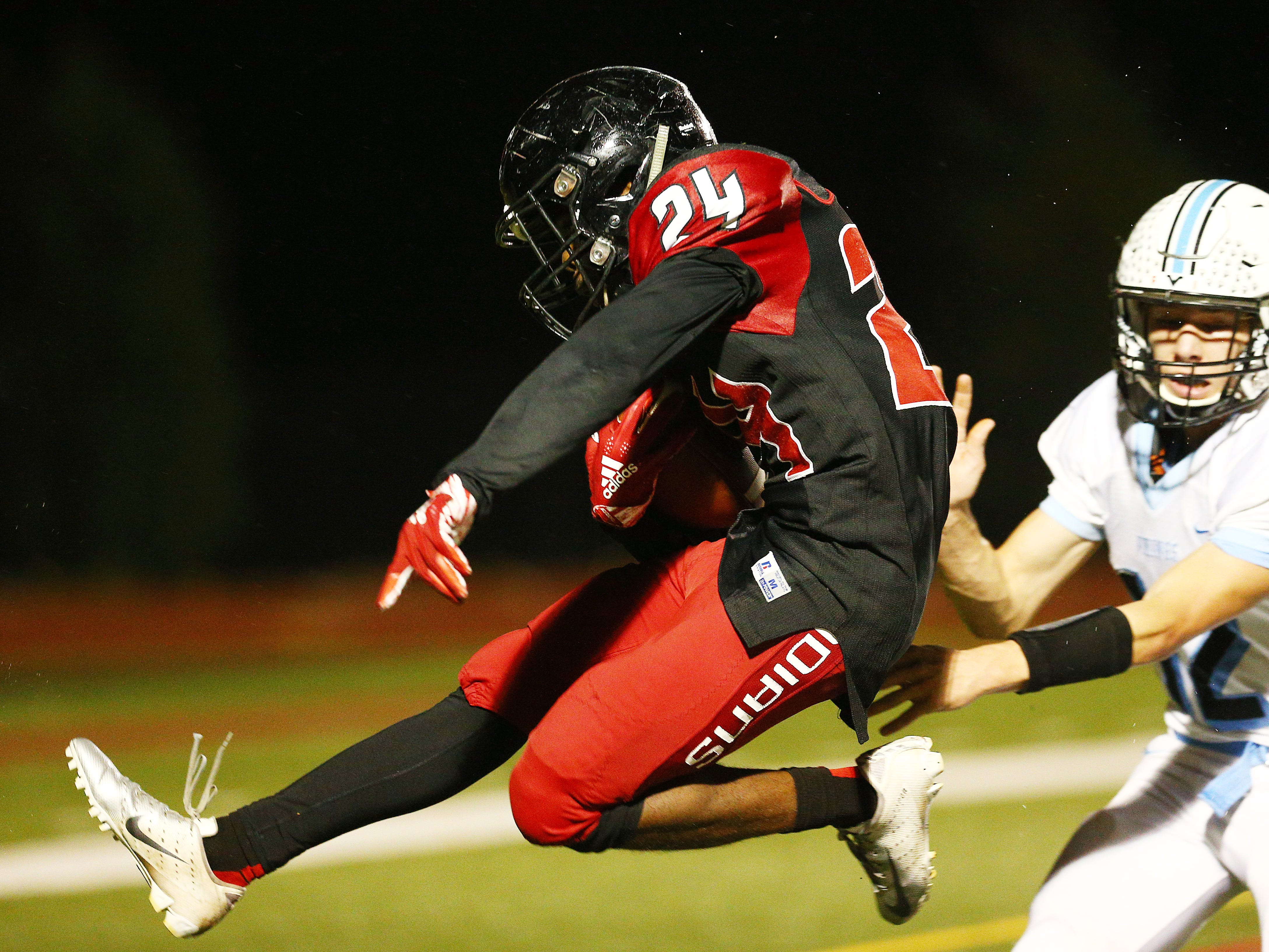 Rahway's Zi'on Pendleton hurdles into the end zone for a second half touchdown vs. Parsippany Hills during their NJSIAA North 2 Group III football quarterfinal at Rahway River Park. November 2, 2018, Rahway, NJ