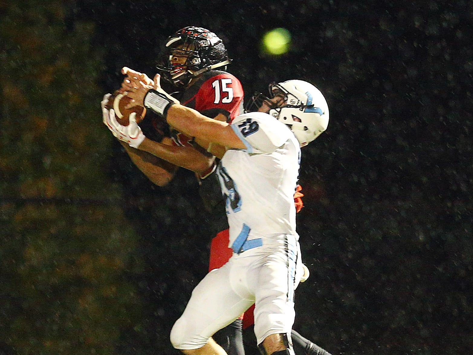 Rahway's Mark Bails pulls in a TD pass despite great defense by Parsippany Hills Kevin Minardi during their NJSIAA North 2 Group III football quarterfinal at Rahway River Park. November 2, 2018, Rahway, NJ