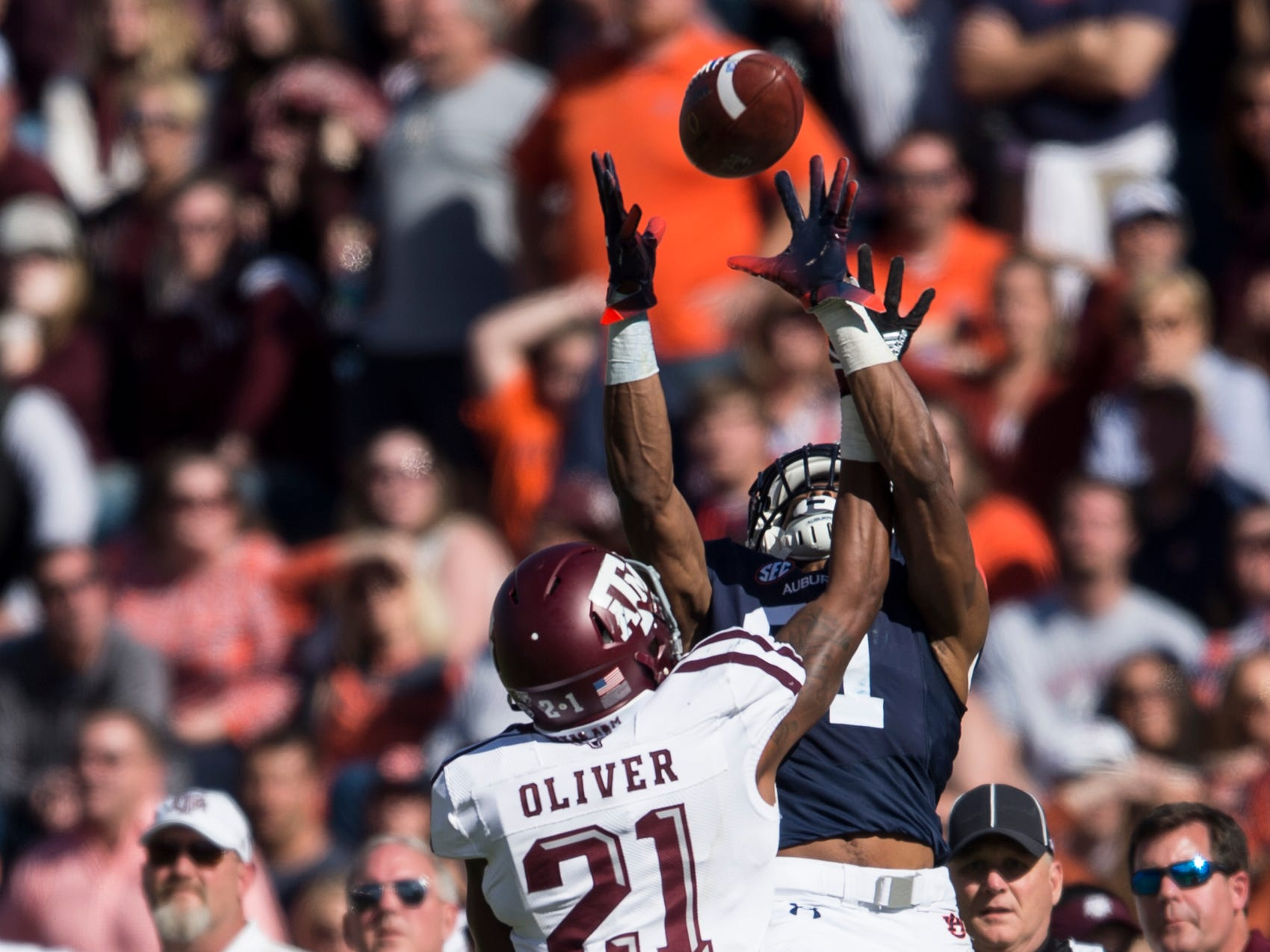Auburn wide receiver Darius Slayton (81) attempts to catch a pass broken up by Texas A&M defensive back Charles Oliver (21) at Jordan-Hare Stadium on Saturday, Nov. 3, 2018. Auburn defeated Texas A&M 28-24.