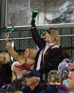 A proud Holtville mom celebrates after a touchdown during the first half.