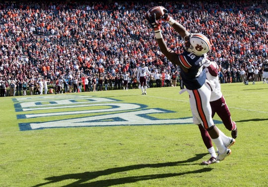 Auburn wide receiver Seth Williams (18) catches the game winning touchdown pass in the end zone against Texas A&M at Jordan-Hare Stadium on Saturday, Nov. 3, 2018. Auburn defeated Texas A&M 28-24.
