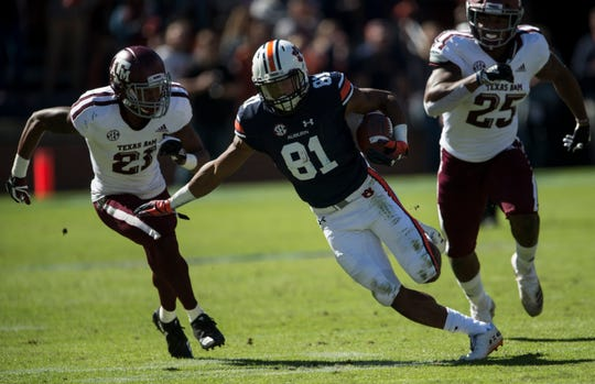Auburn wide receiver Darius Slayton (81) turns up field after making a catch against Texas A&M at Jordan-Hare Stadium on Saturday, Nov. 3, 2018.